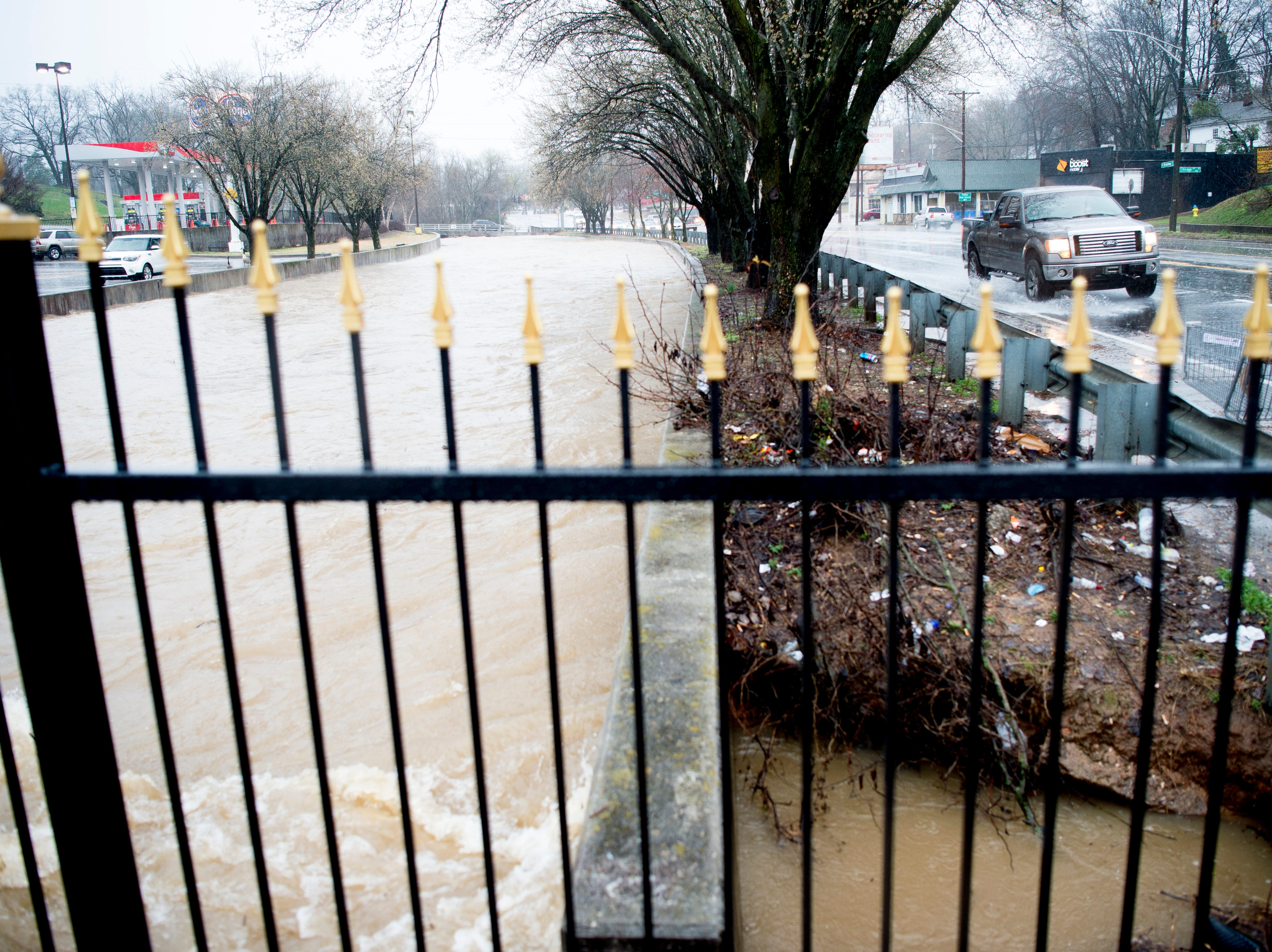The First Creek overflows as seen from the Broadway Kroger during a heavy rainstorm in Knoxville, Tennessee on Saturday, February 23, 2019. The Knoxville area could see between 2 and 3 inches through the weekend.