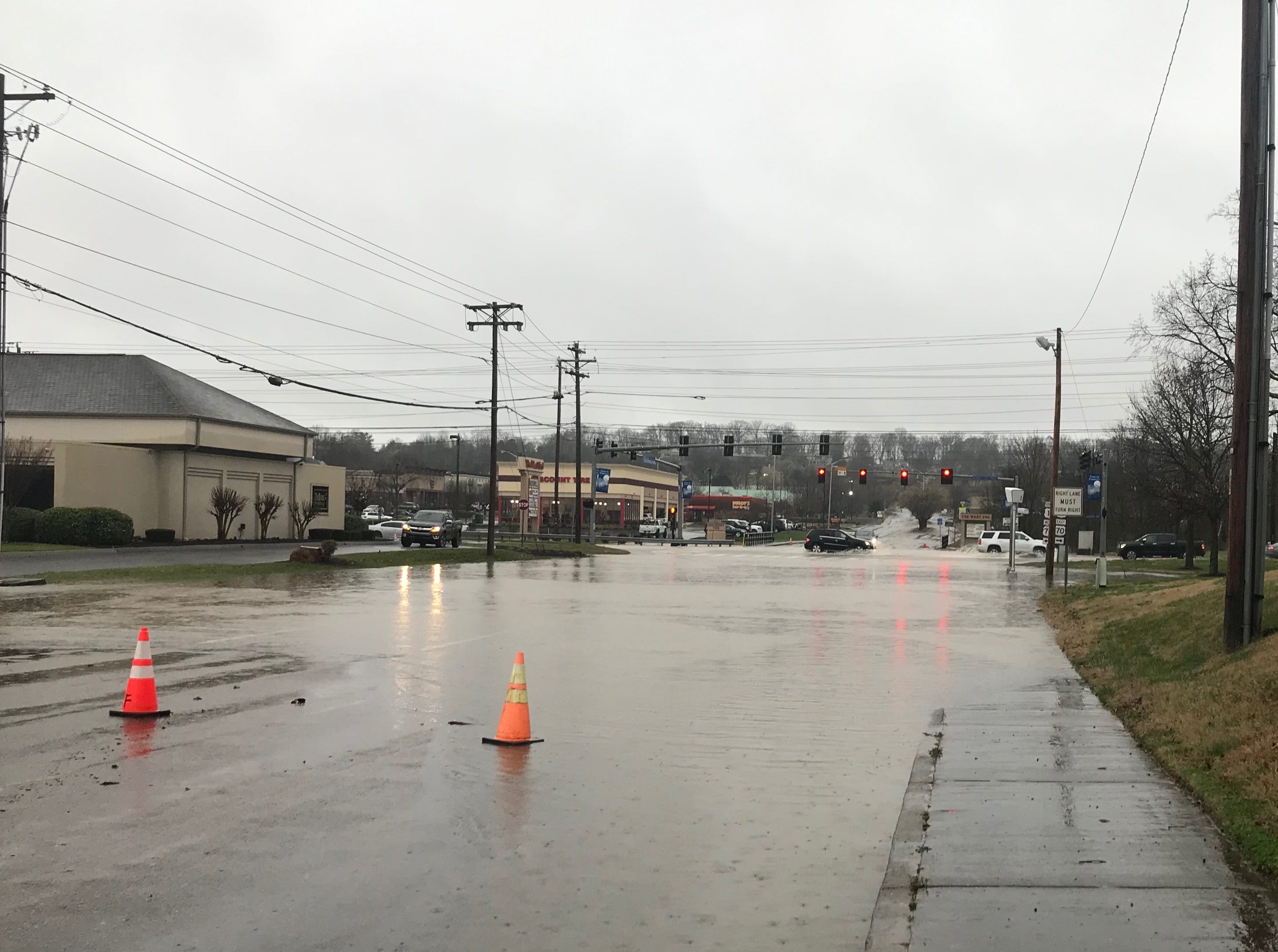 Concord Road was closed Saturday morning near Kingston Pike due to flooding from Turkey Creek.