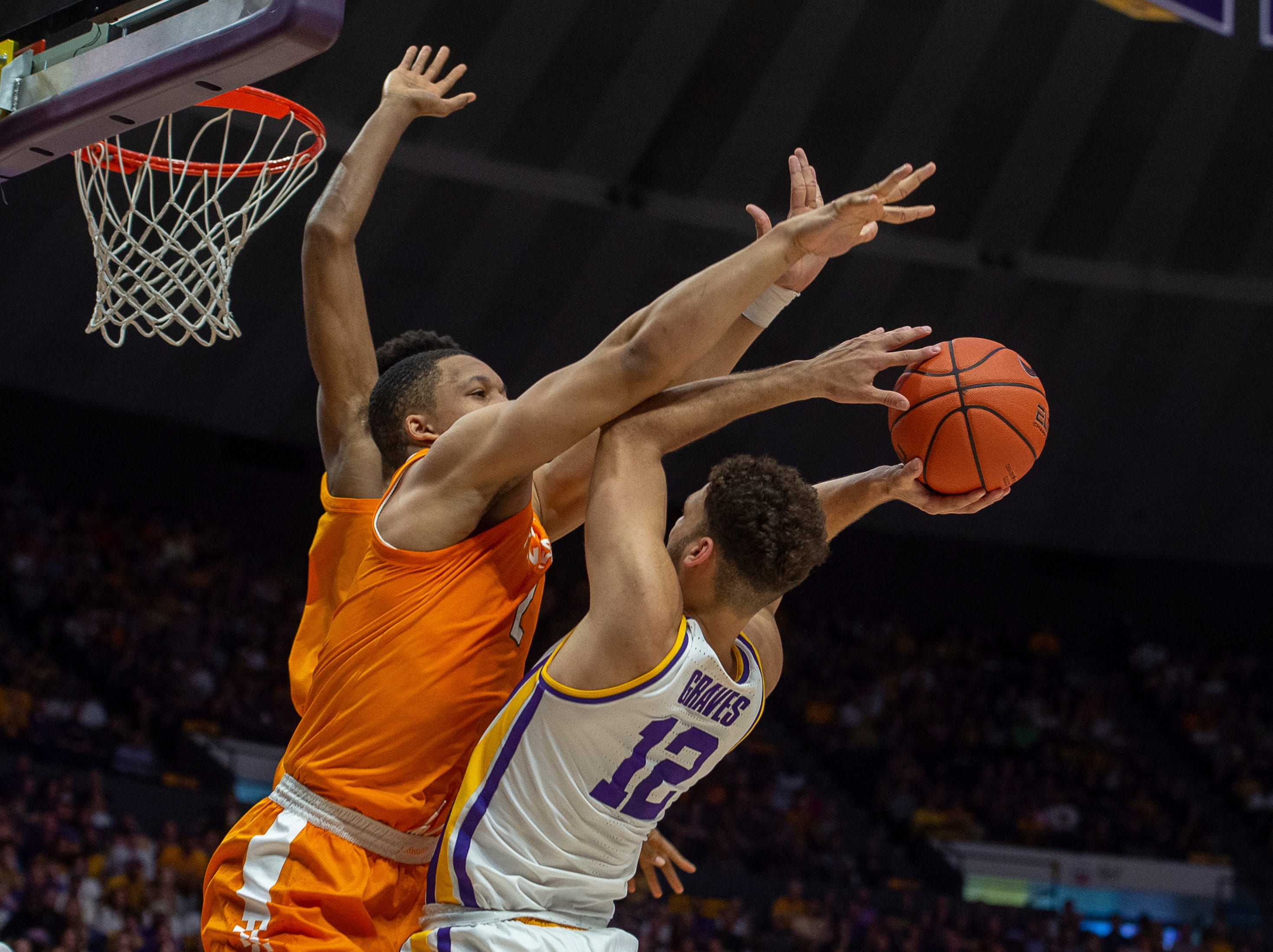 LSU's Marshall Graves takes a shot and blocked by Tennessee's Grant Williams during an NCAA college basketball game, Saturday, Feb. 23, 2019, in Baton Rouge, La. (Scott Clause/The Daily Advertiser via AP)