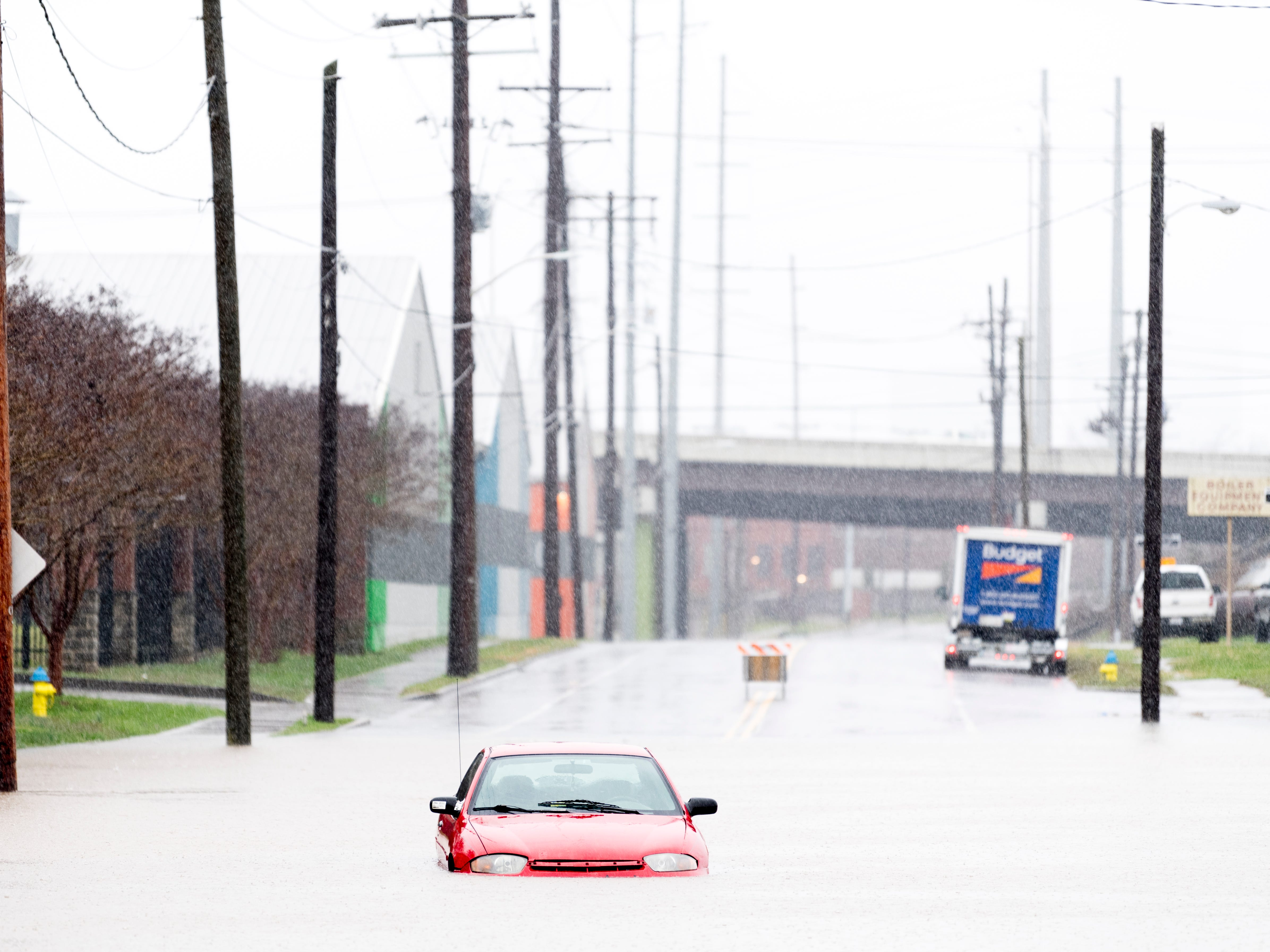A Chevrolet Cavalier is seen stranded along a flooded portion of North 6th Ave. during a heavy rainstorm in Knoxville, Tennessee on Saturday, February 23, 2019. The Knoxville area could see between 2 and 3 inches through the weekend.