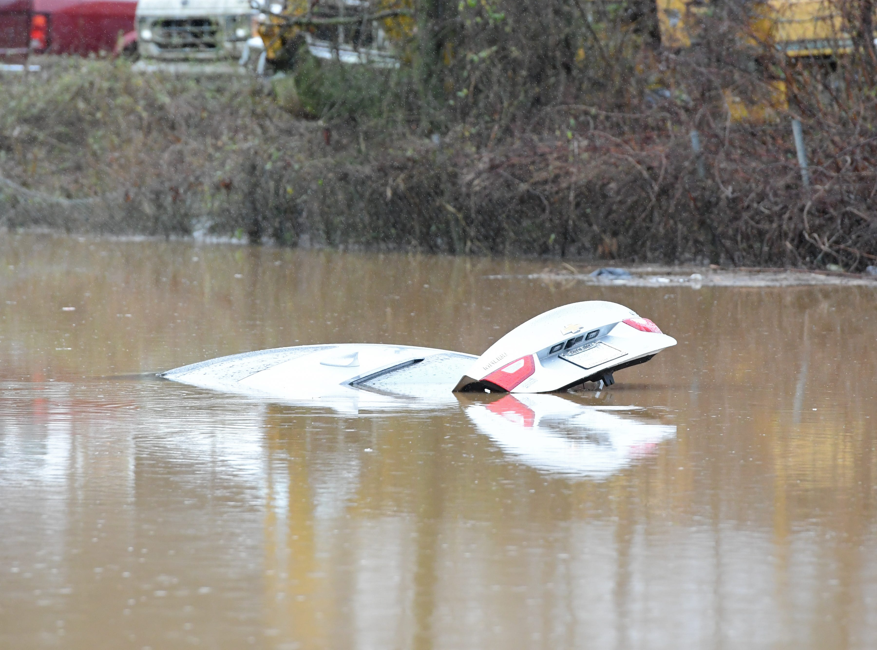 A car is submerged due to flooding at West Emory Road and Sharp Road in Powell Saturday Feb. 23, 2019. The Knoxville area could see between 2 and 3 inches of rain through the weekend.