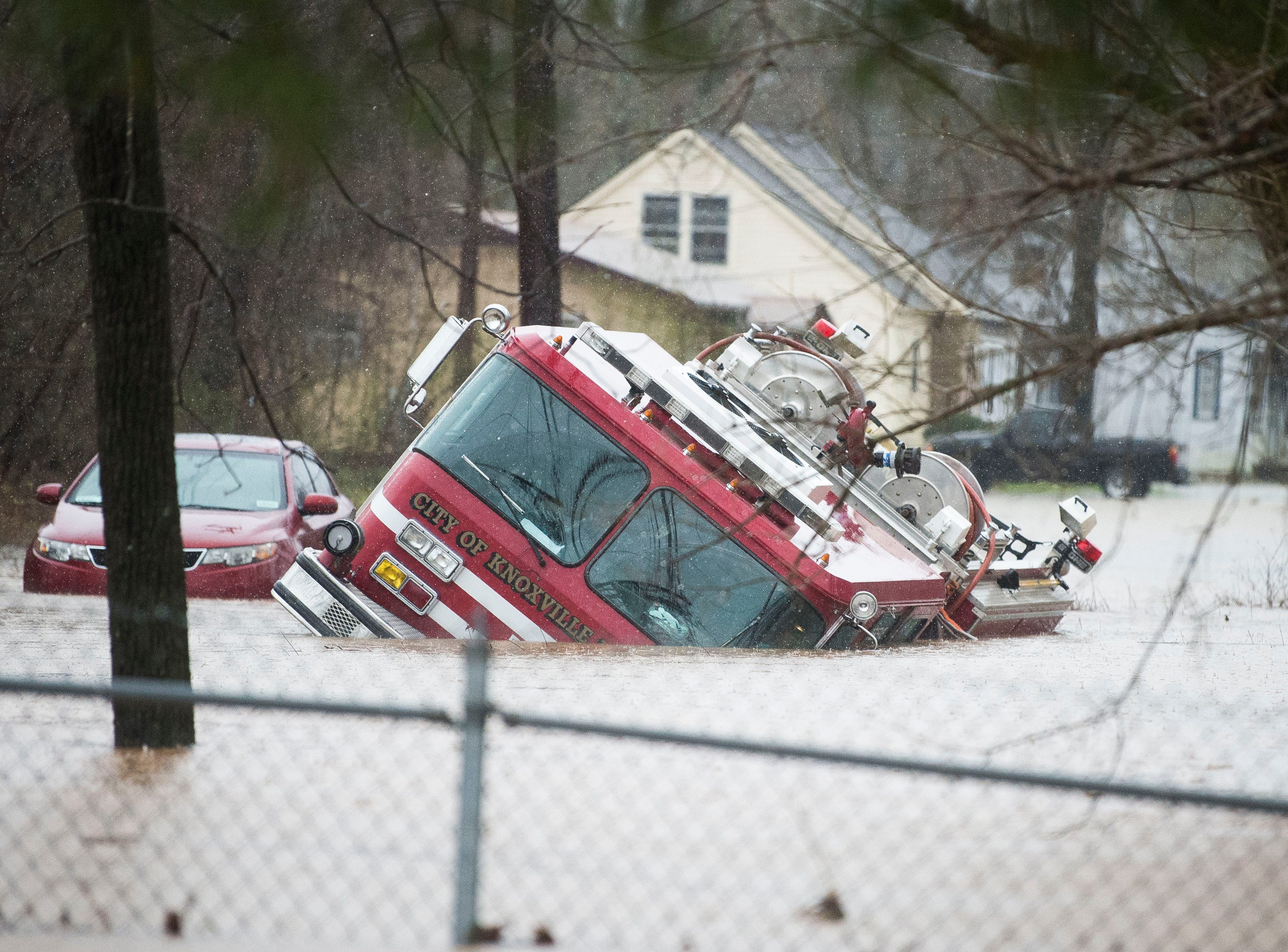 A firetruck is overtaken by flood water near the Kroger in Fountain City Saturday, Feb. 23, 2019. The Knoxville area could see between 2 and 3 inches through the weekend.