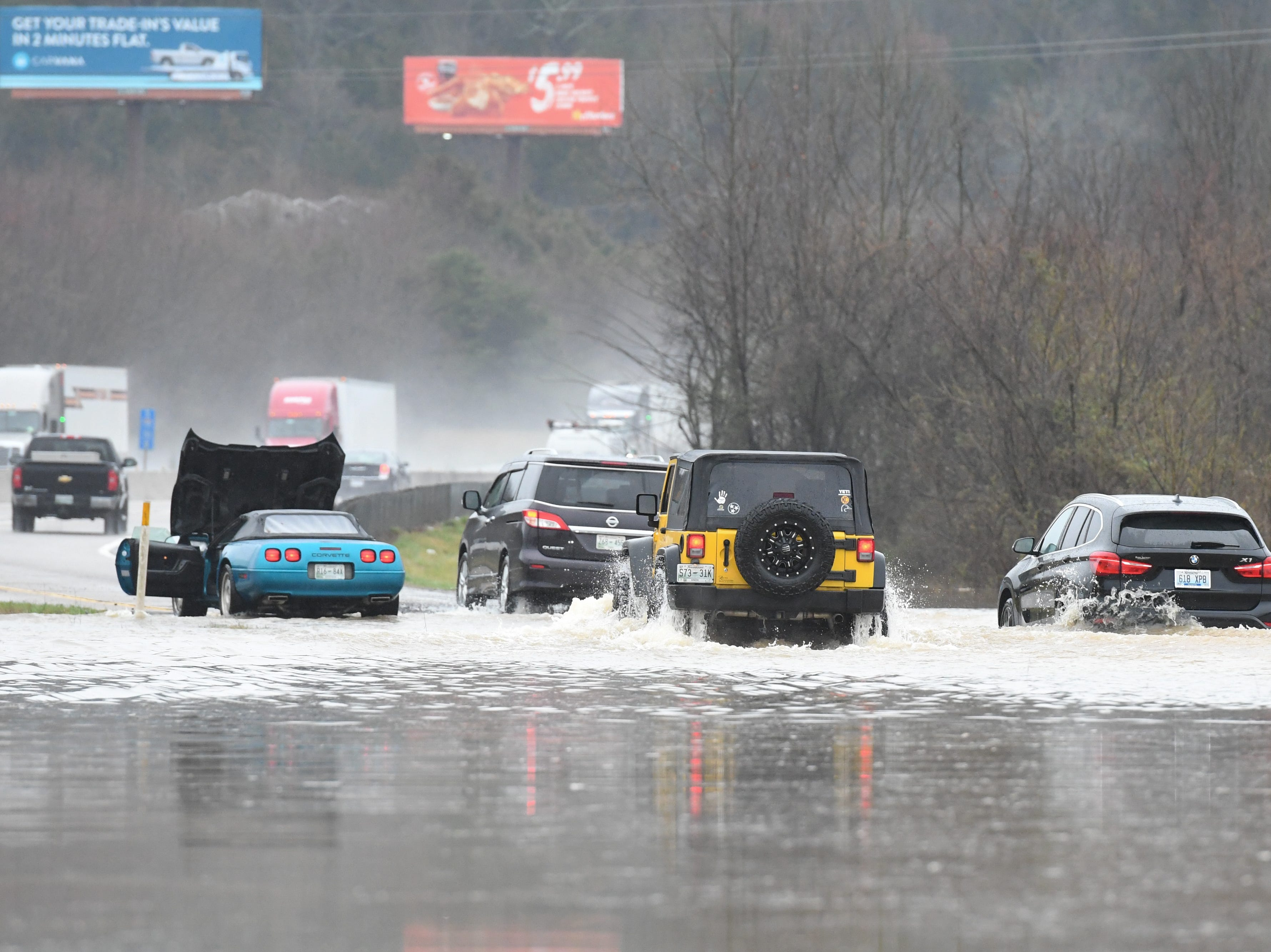 Motorists navigate the flooded entrance ramp to I-75 South from Emory Road in Knox County Saturday Feb. 23, 2019. The Knoxville area could see between 2 and 3 inches of rain through the weekend.
