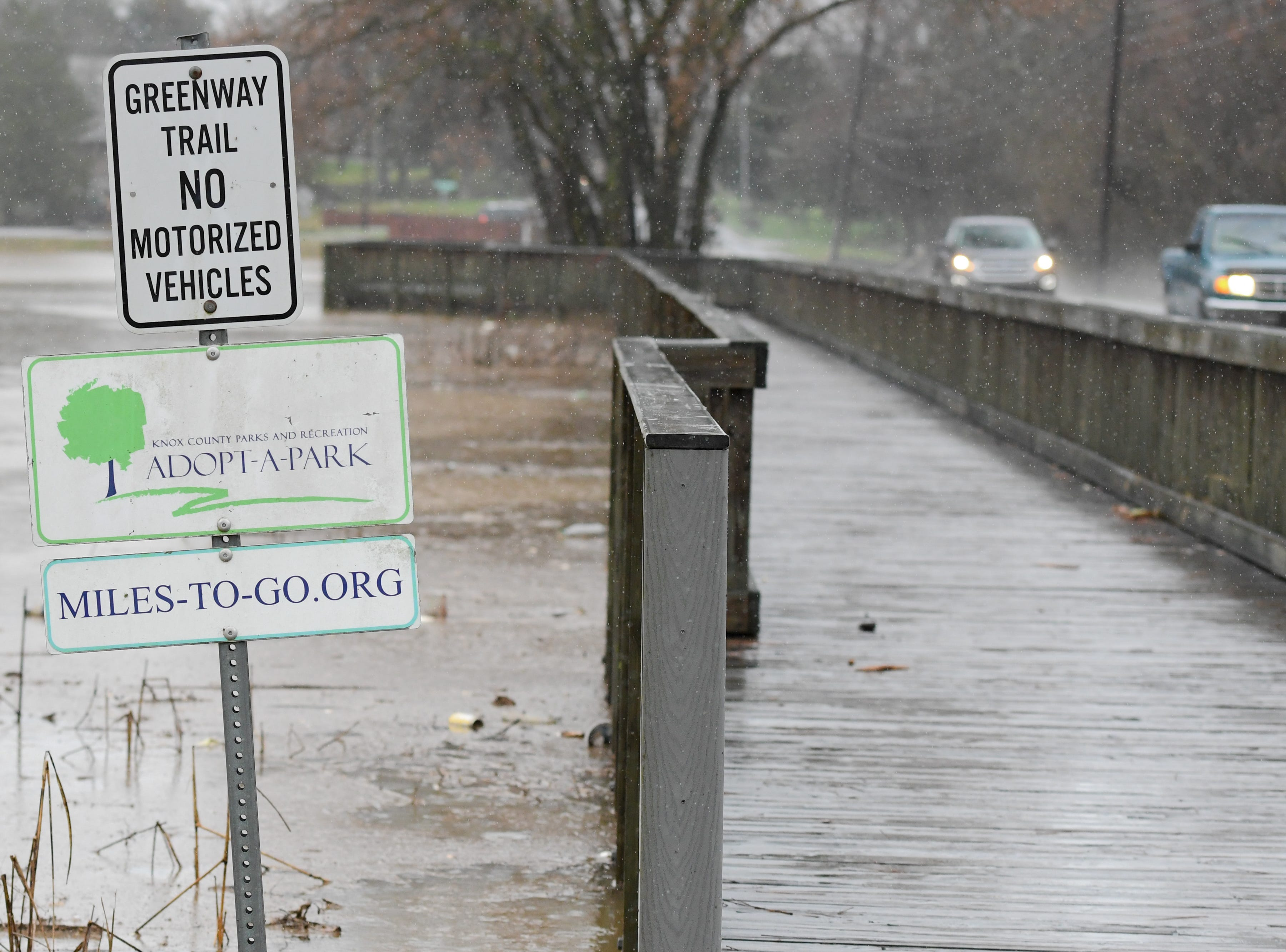 Beaver Creek overflows due to flooding in front of Powell Middle School on West Emory Road in Powell Saturday Feb. 23, 2019. The Knoxville area could see between 2 and 3 inches of rain through the weekend.
