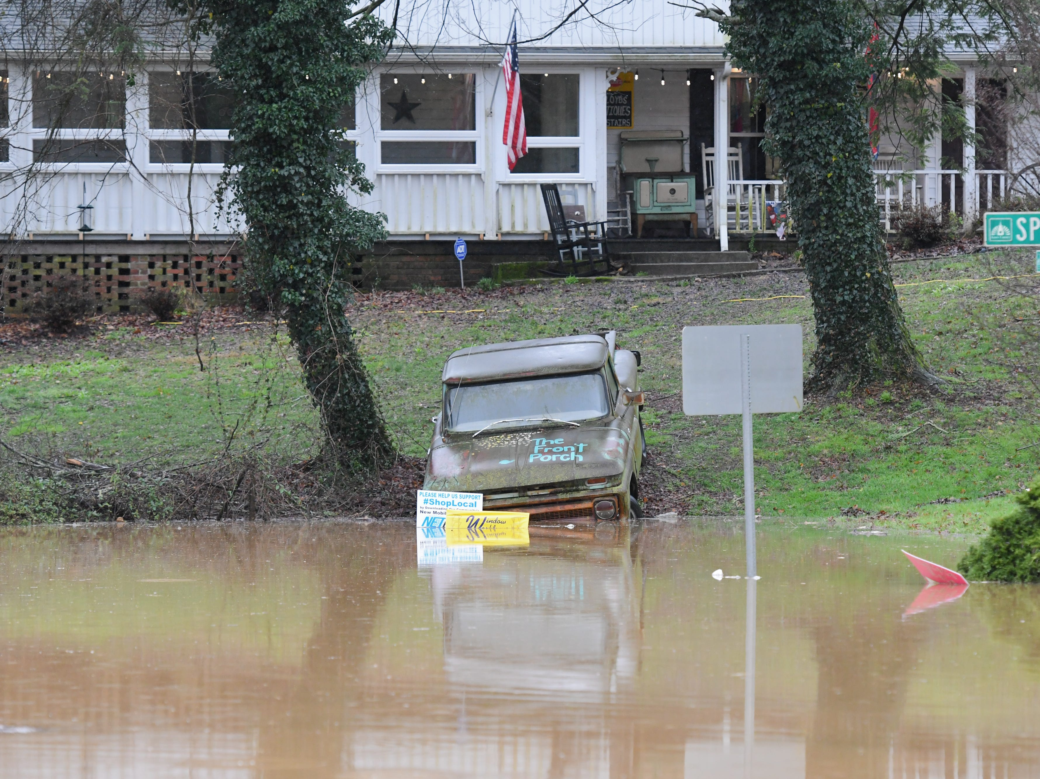 Beaver Creek overflows due to flooding in front of The Front Porch restaurant at West Emory Road and Spring Street in Powell Saturday Feb. 23, 2019. The Knoxville area could see between 2 and 3 inches of rain through the weekend.