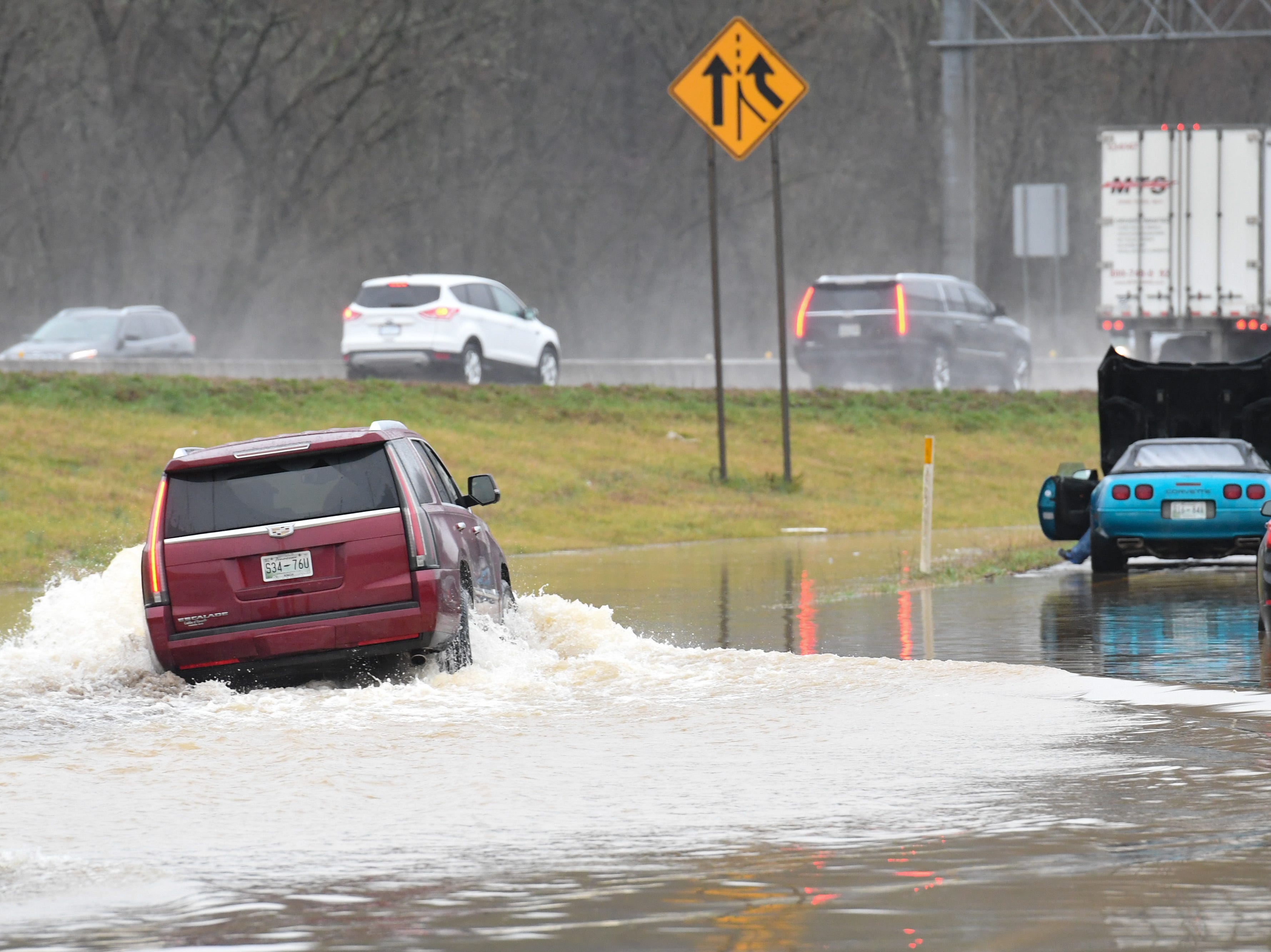 A motorist navigates the flooded entrance ramp to I-75 South from Emory Road in Knox County Saturday Feb. 23, 2019. The Knoxville area could see between 2 and 3 inches of rain through the weekend.
