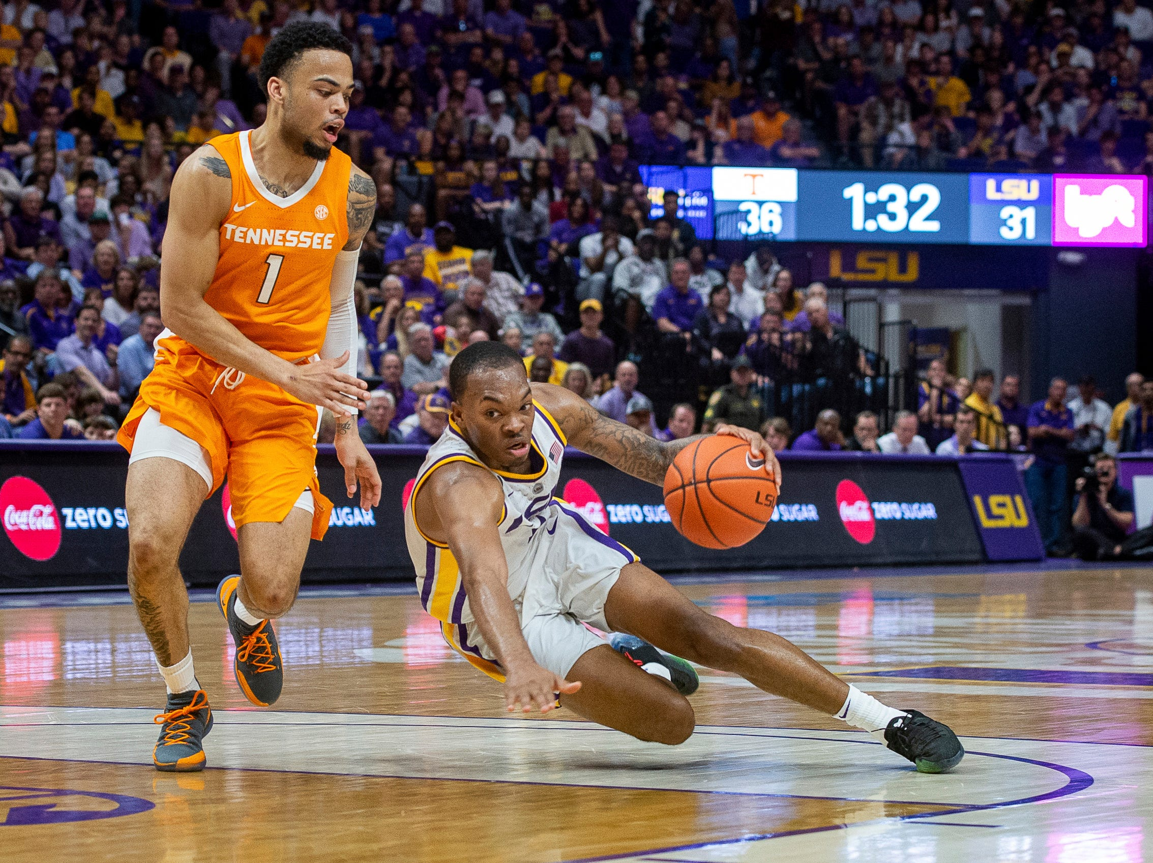 LSU's Javonte Smart, right, falls while driving to the basket past Tennessee's Lamonte' Turner during an NCAA college basketball game, Saturday, Feb. 23, 2019, in Baton Rouge, La. (Scott Clause/The Daily Advertiser via AP)