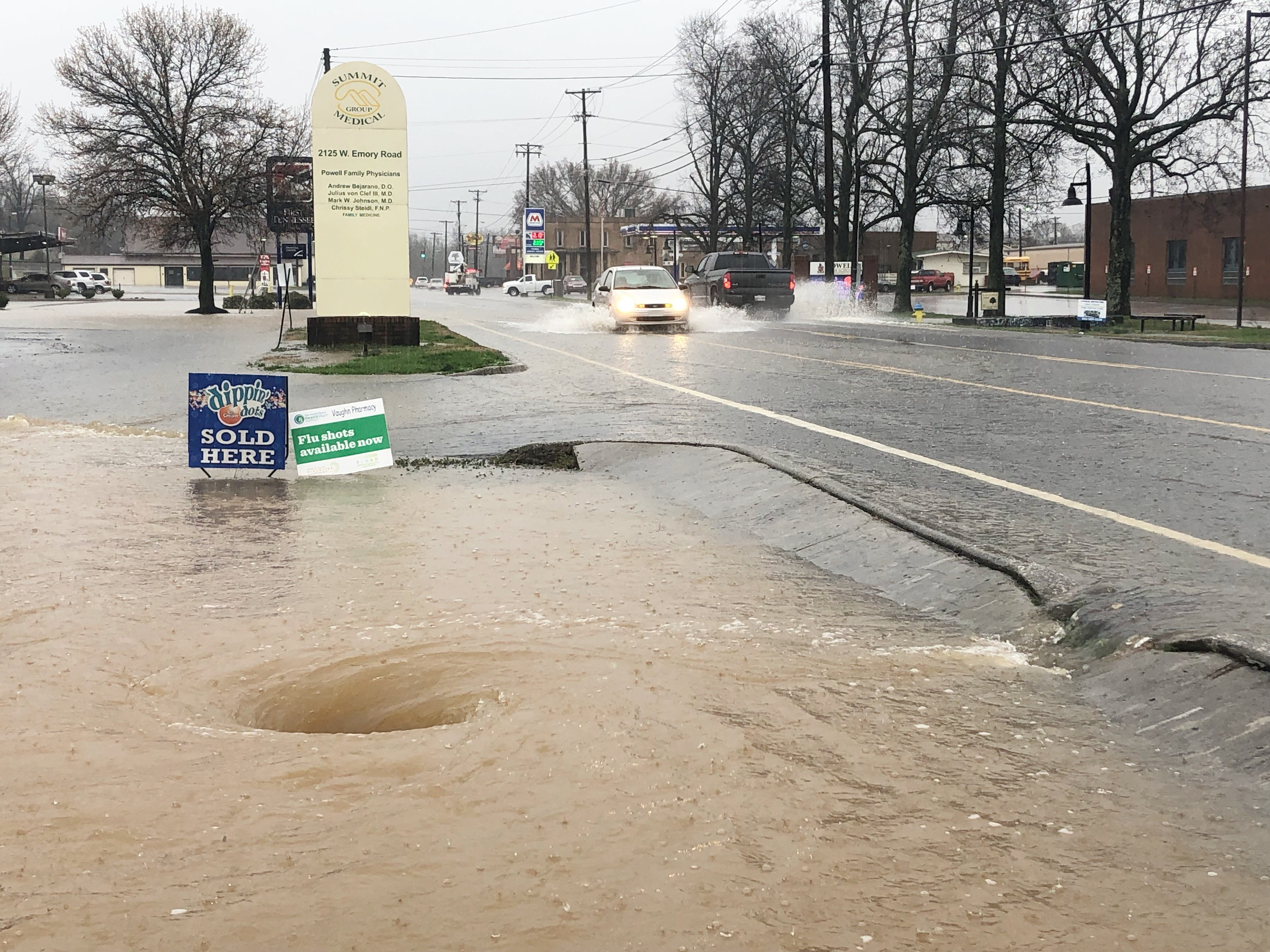 This storm drain in the Vaughn Pharmacy parking lot across from Powell High works overtime to relieve Emory Rd of water. on Saturday, Feb. 23, 2019.