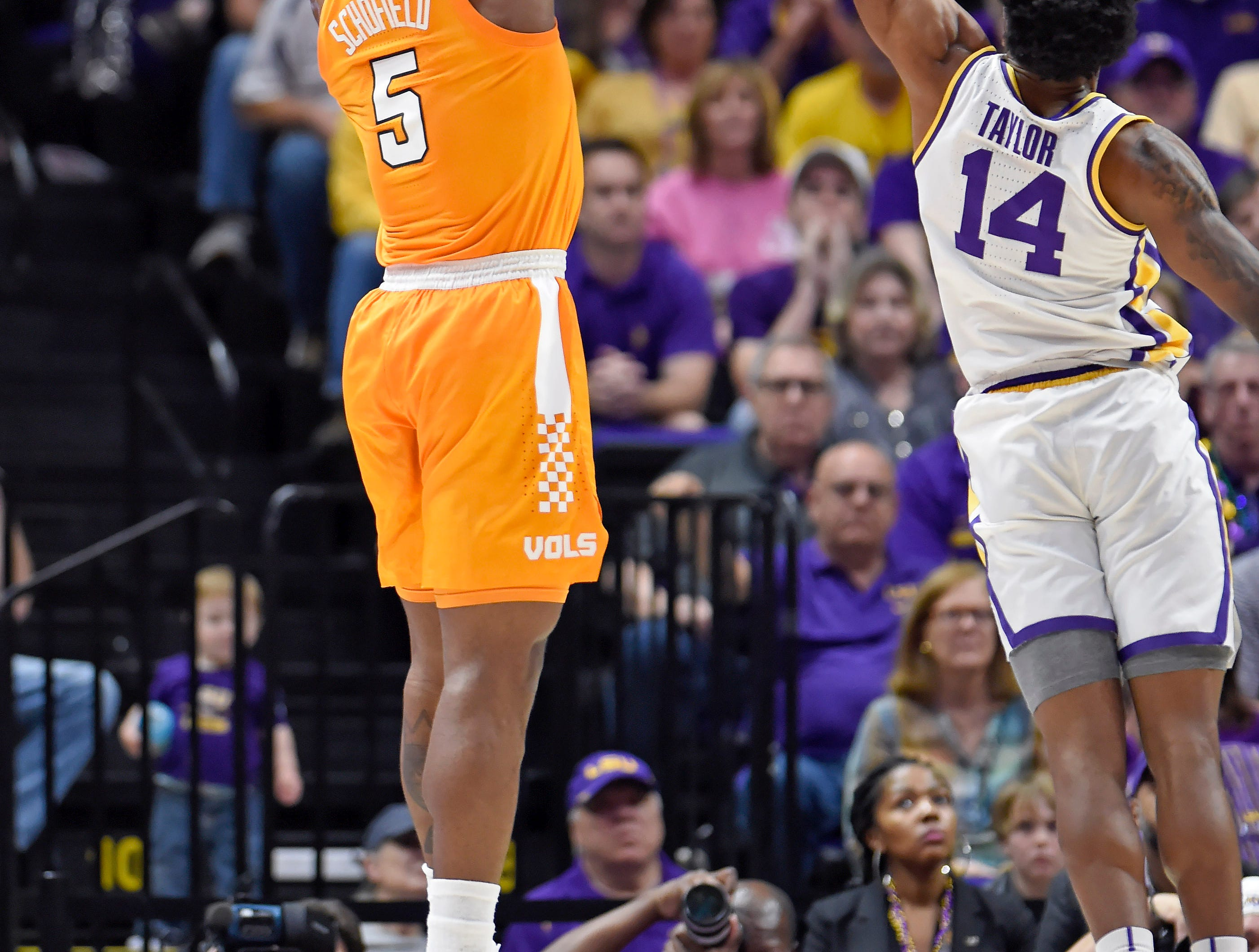 Tennessee guard Admiral Schofield (5) puts the ball up for 3-points as LSU guard Marlon Taylor (14) defends in the first half of an NCAA college basketball game, Saturday, Feb. 23, 2019, in Baton Rouge, La. (AP Photo/Bill Feig)