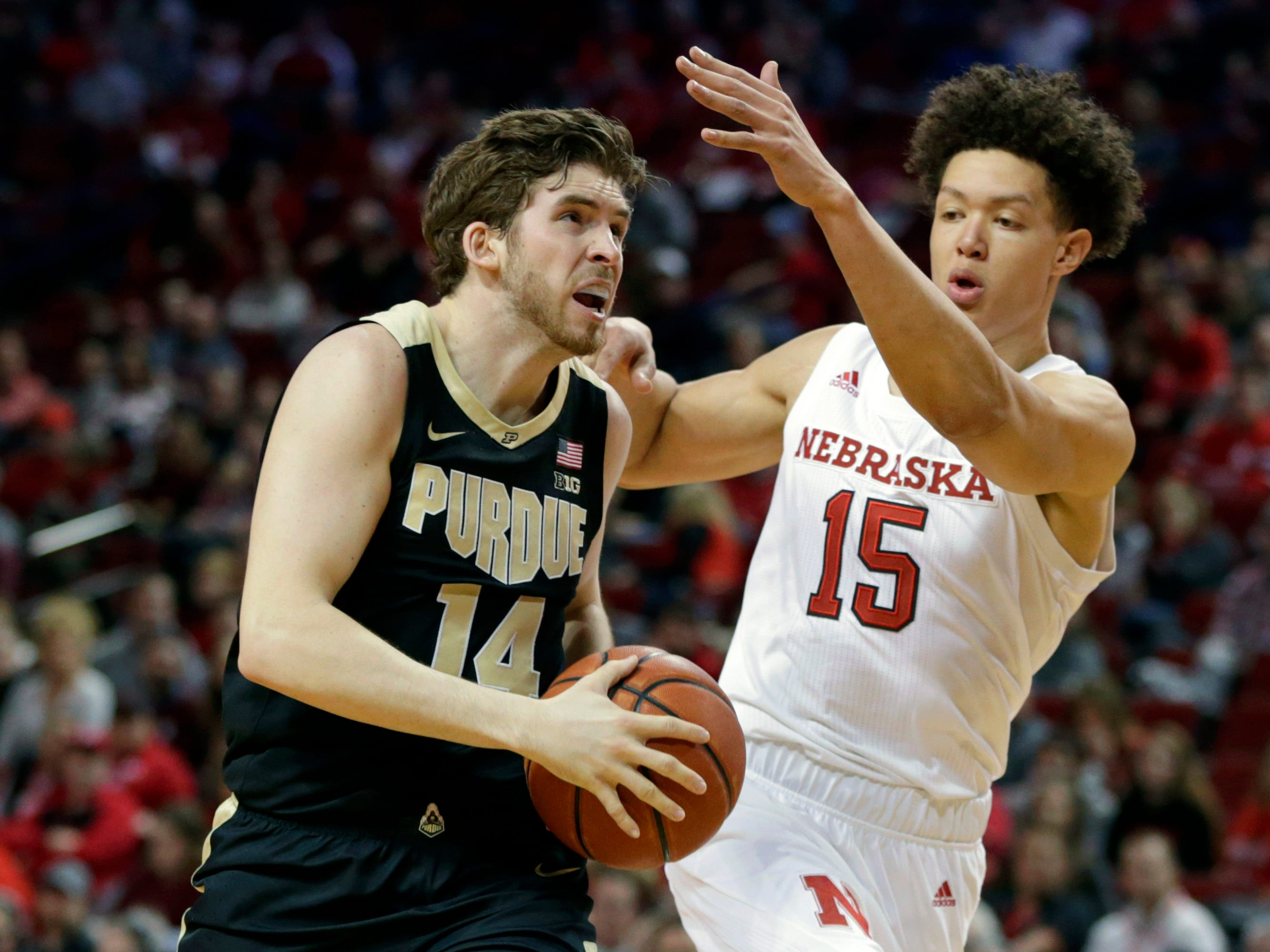 Purdue's Ryan Cline (14) goes to the basket against Nebraska's Isaiah Roby (15) during the first half of an NCAA college basketball game in Lincoln, Neb., Saturday, Feb. 23, 2019.