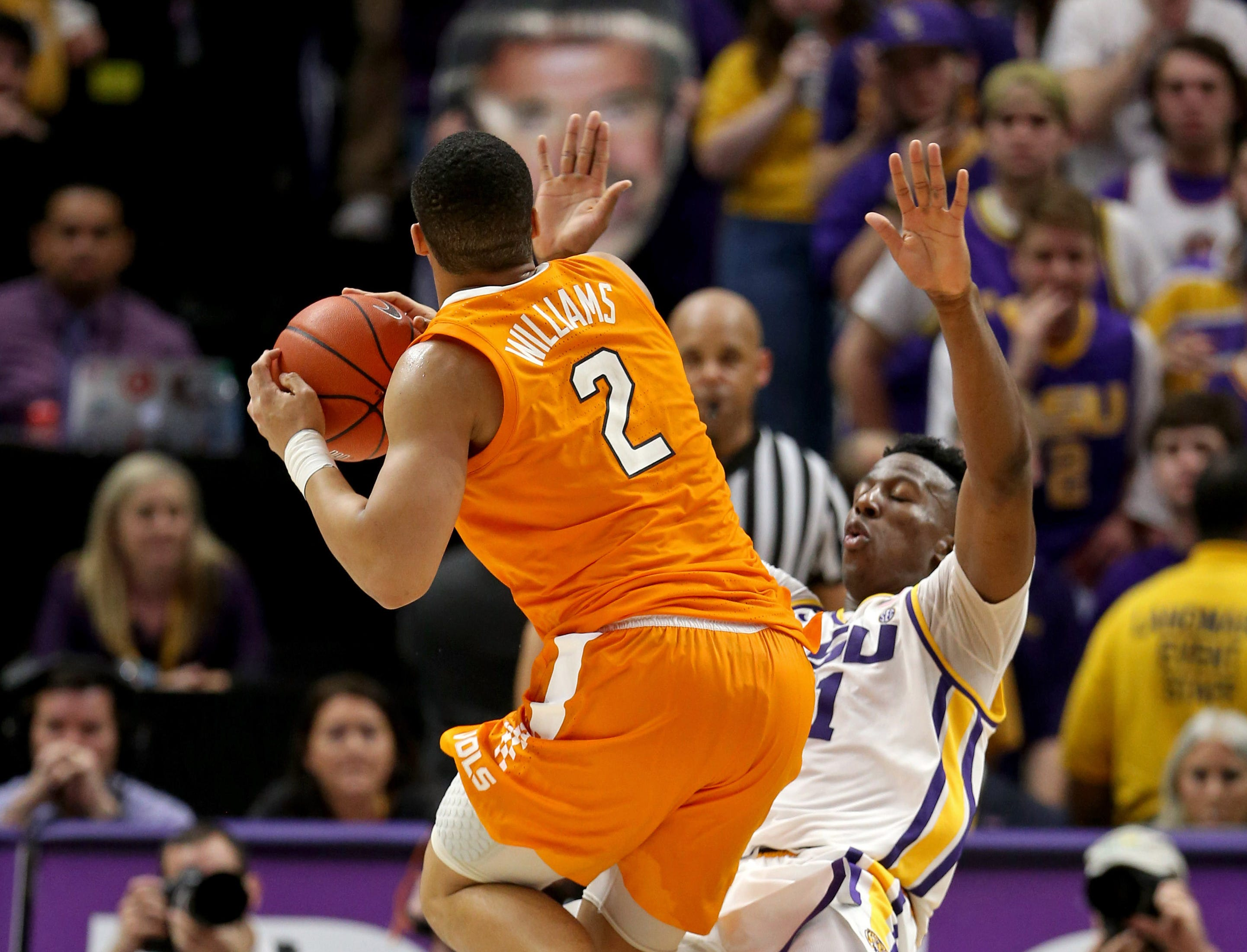 Feb 23, 2019; Baton Rouge, LA, USA; Tennessee Volunteers forward Grant Williams (2) makes an offensive foul in overtime against LSU Tigers forward Kavell Bigby-Williams (11) at the Maravich Assembly Center. LSU won, 82-80 in overtime. Mandatory Credit: Chuck Cook-USA TODAY Sports
