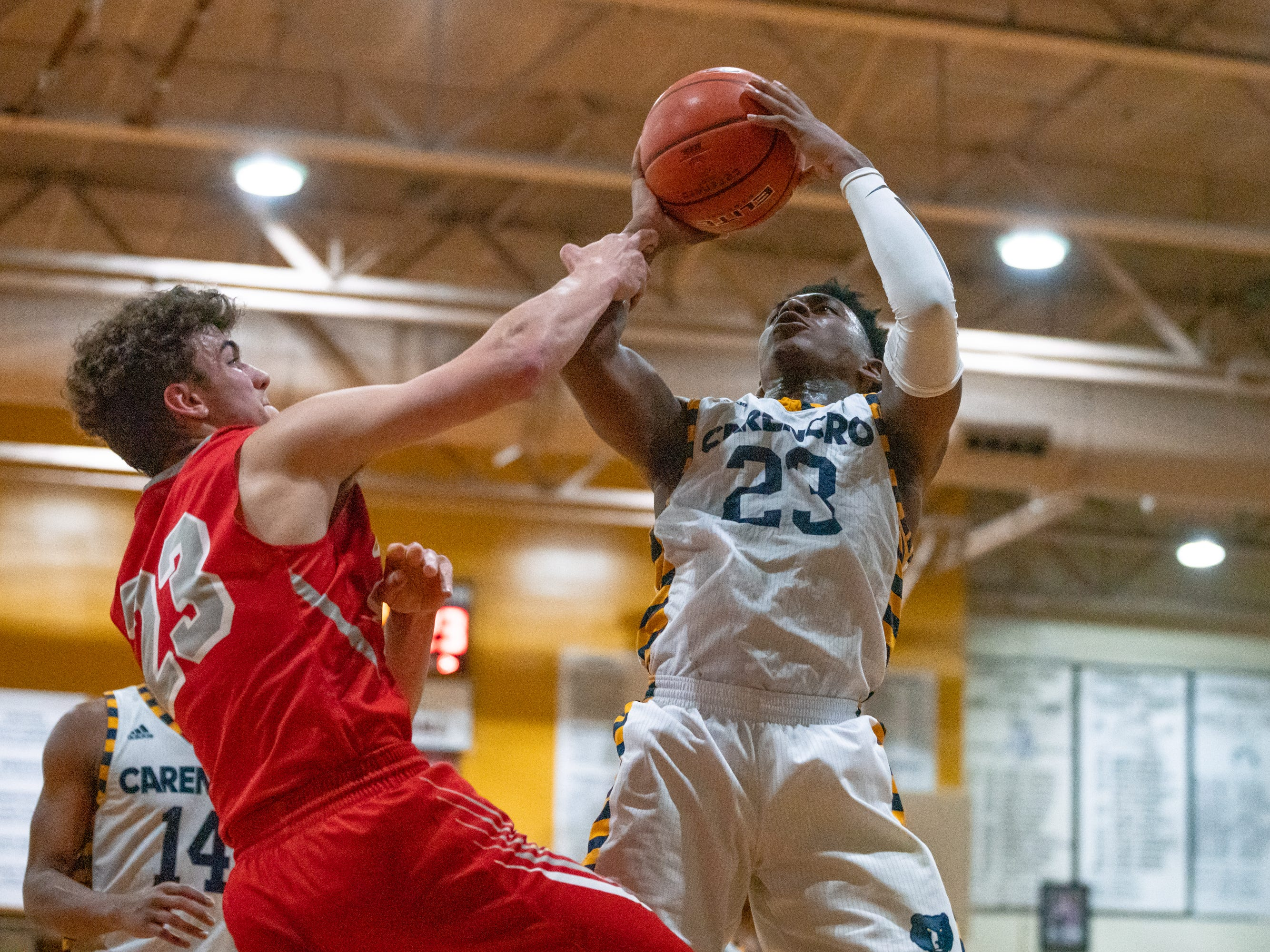 Carencro High's Lucas Williams scores over a defender as the Carencro High Bears take on the Pearl River Rebels at home on Friday, Feb. 22, 2019.