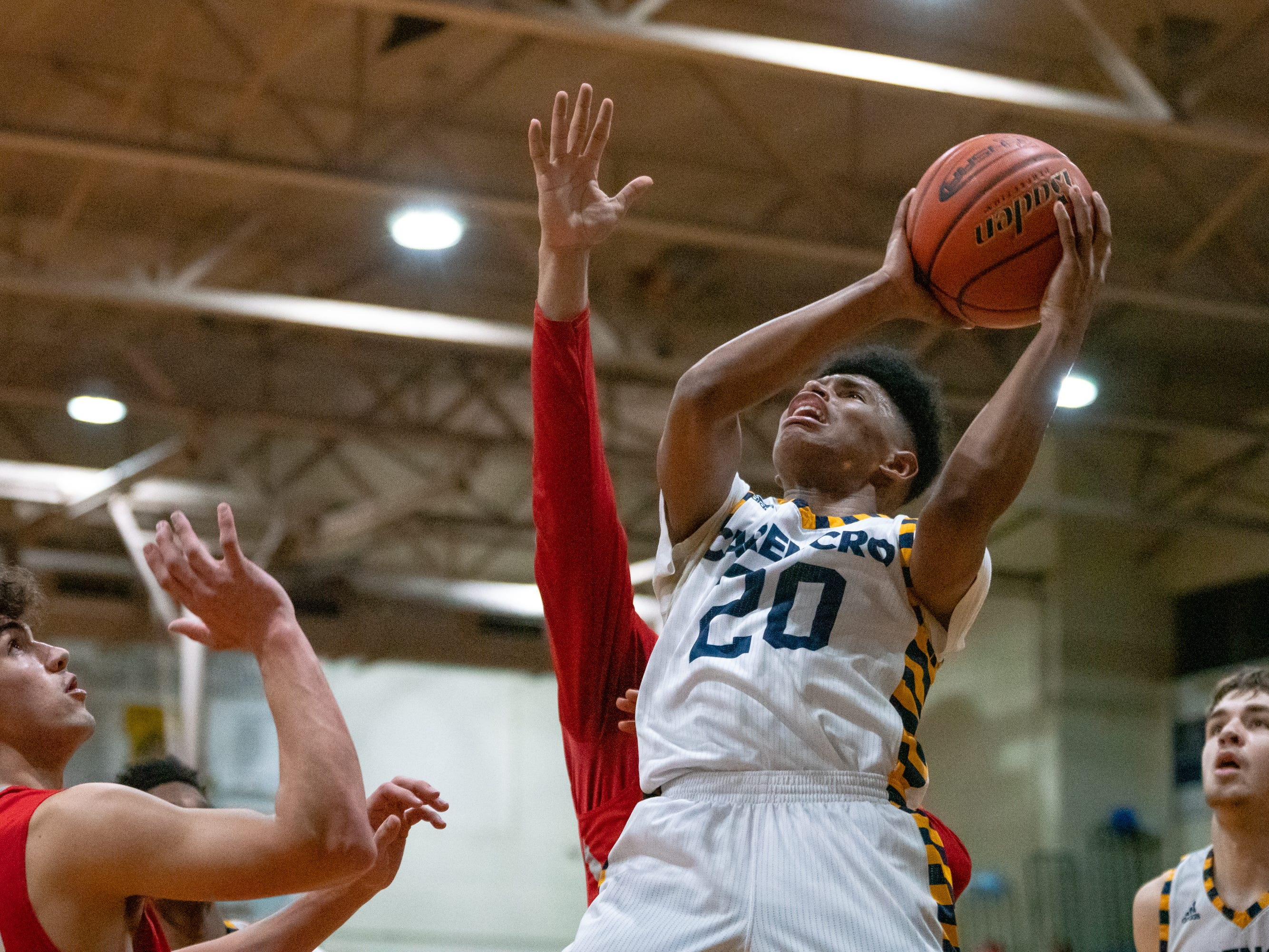 Carencro High's Jatrell Marks takes a shot underneath the goal as the Carencro High Bears take on the Pearl River Rebels at home on Friday, Feb. 22, 2019.