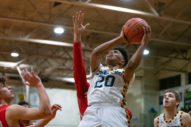 Carencro High junior Jatrell Marks takes a shot under the goal, as the Bears face Pearl River on Feb. 22.