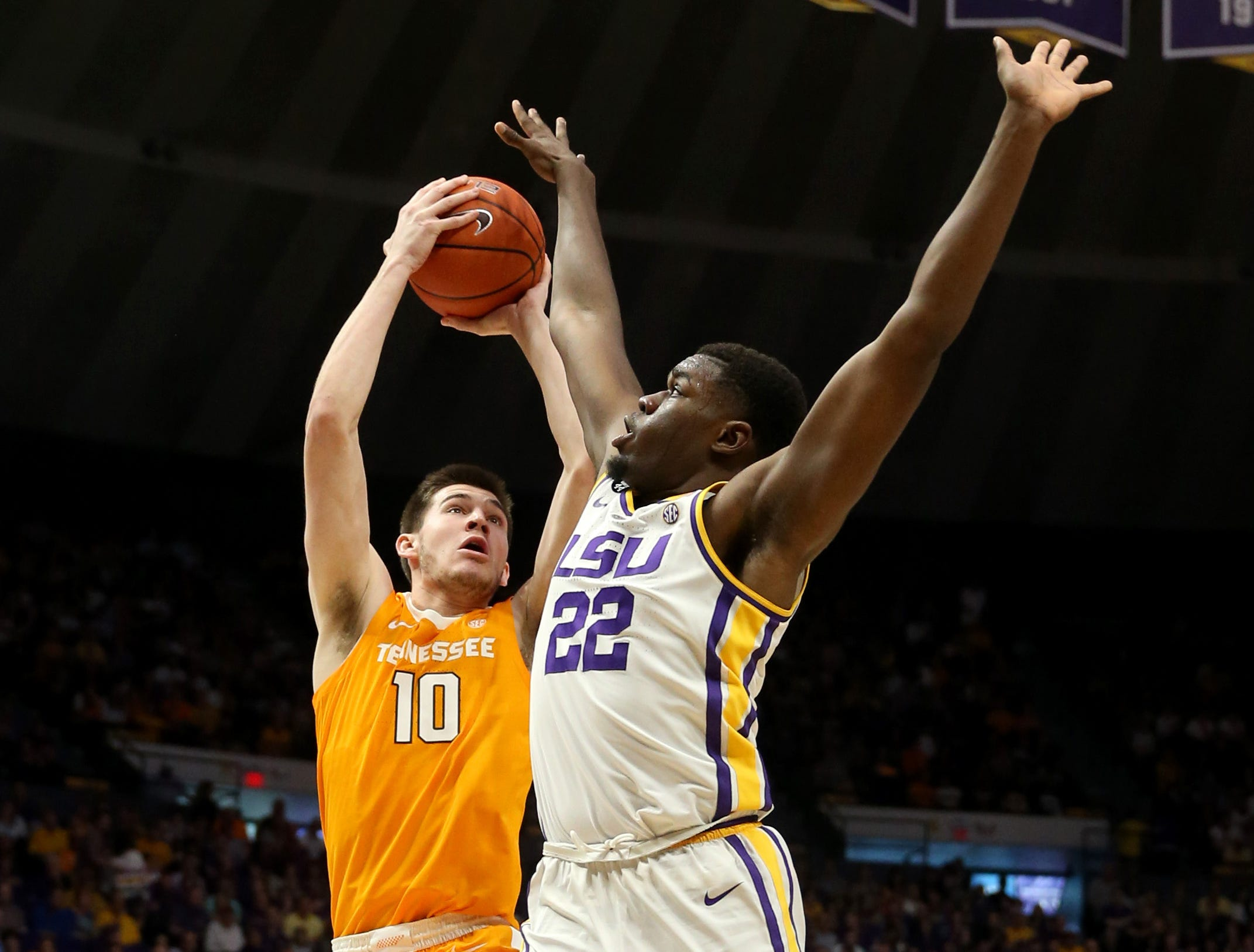 Feb 23, 2019; Baton Rouge, LA, USA; The shot by Tennessee Volunteers forward John Fulkerson (10) is defended by LSU Tigers forward Darius Days (22) in the first half at the Maravich Assembly Center. Mandatory Credit: Chuck Cook-USA TODAY Sports