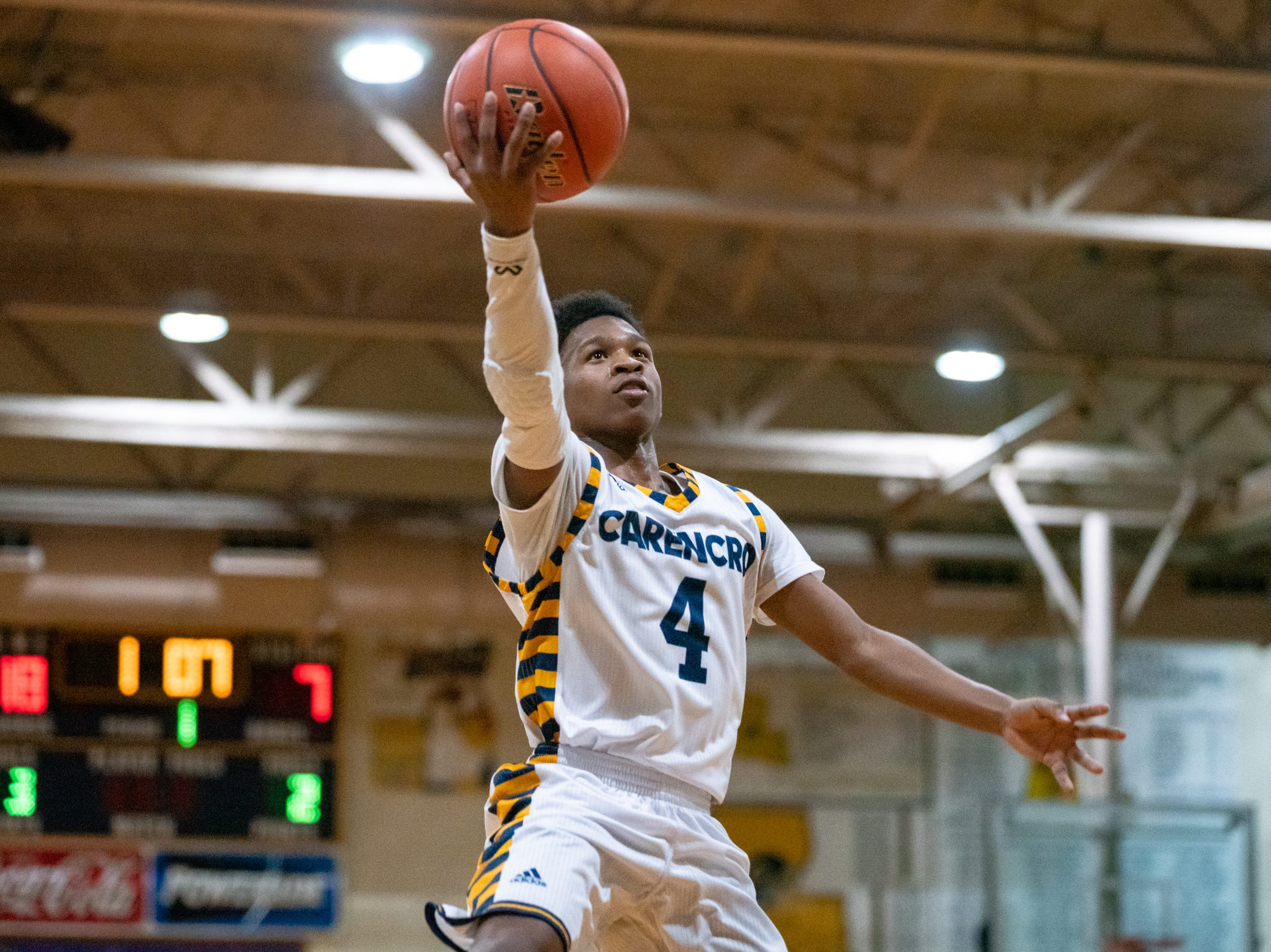 Carencro High's Artrell Marks leaps up to the goal to score as the Carencro High Bears take on the Pearl River Rebels at home on Friday, Feb. 22, 2019.