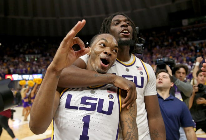 Feb 23, 2019; Baton Rouge, LA, USA; LSU Tigers guard Ja'vonte Smart (1) celebrates with forward Naz Reid (0) after their game against the Tennessee Volunteers at the Maravich Assembly Center. LSU won, 82-80 in overtime. Mandatory Credit: Chuck Cook-USA TODAY Sports