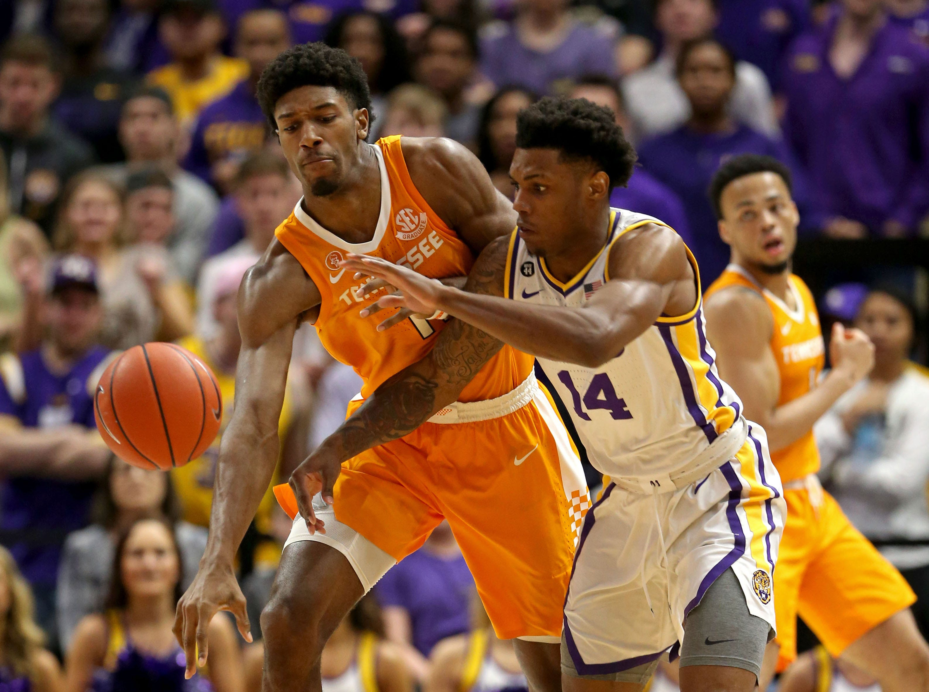 Feb 23, 2019; Baton Rouge, LA, USA; Tennessee Volunteers forward Kyle Alexander (11) and LSU Tigers guard Marlon Taylor (14) fight for the ball in the first half at the Maravich Assembly Center. Mandatory Credit: Chuck Cook-USA TODAY Sports