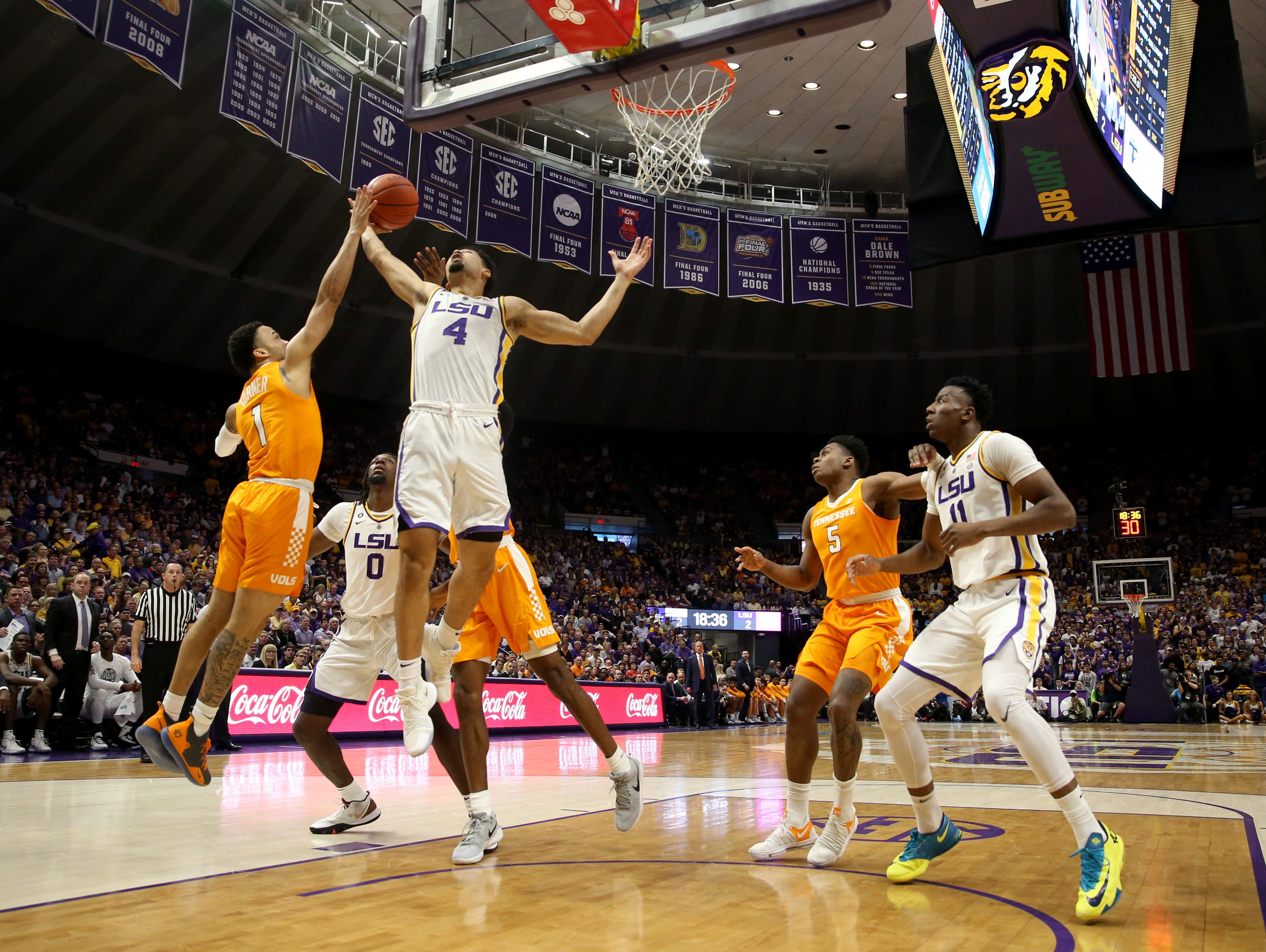 Feb 23, 2019; Baton Rouge, LA, USA; Tennessee Volunteers guard Lamonte Turner (1) and LSU Tigers guard Skylar Mays (4) fight for a rebound in the first half at the Maravich Assembly Center. Mandatory Credit: Chuck Cook-USA TODAY Sports