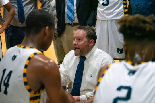 Carencro High's head coach Chris Kovatch talks to his players during half-time as the Carencro High Bears take on the Pearl River Rebels at home on Friday, Feb. 22, 2019.