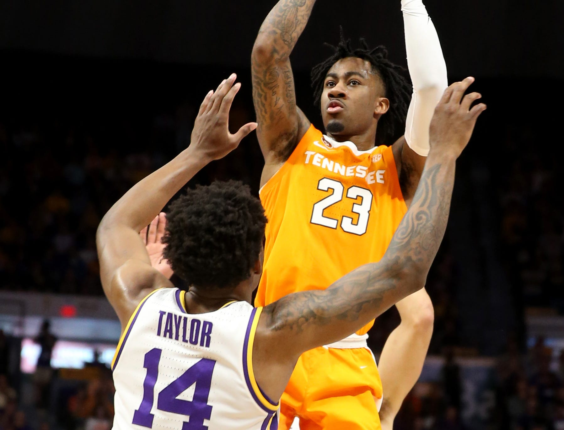 Feb 23, 2019; Baton Rouge, LA, USA; Tennessee Volunteers guard Jordan Bowden (23) is defended by LSU Tigers guard Marlon Taylor (14) in the first half at the Maravich Assembly Center. Mandatory Credit: Chuck Cook-USA TODAY Sports