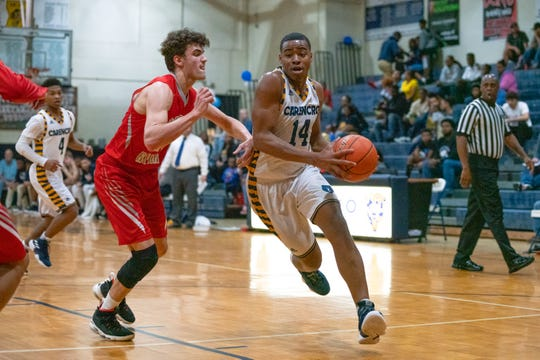 Carencro's Julian Landor drives to the basket Friday as the Bears defeated Pearl River in the Class 4A bi-district round.