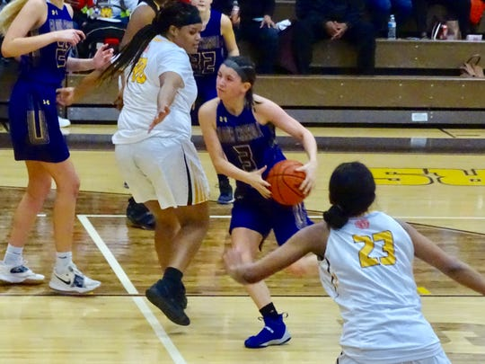 Bloom-Carroll's Makenzee Mason splits the Beechcroft defense during the Bulldogs' 53-34 win.
