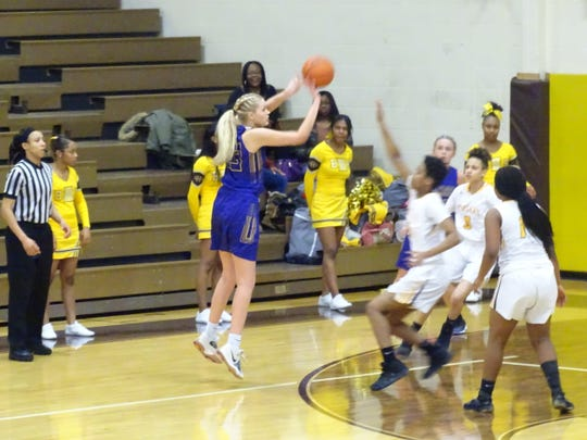Bloom-Carroll's Chloe Davis shoots a 3-pointer against Beechcroft during the Bulldogs' 53-34 Division II tournament win Friday night.