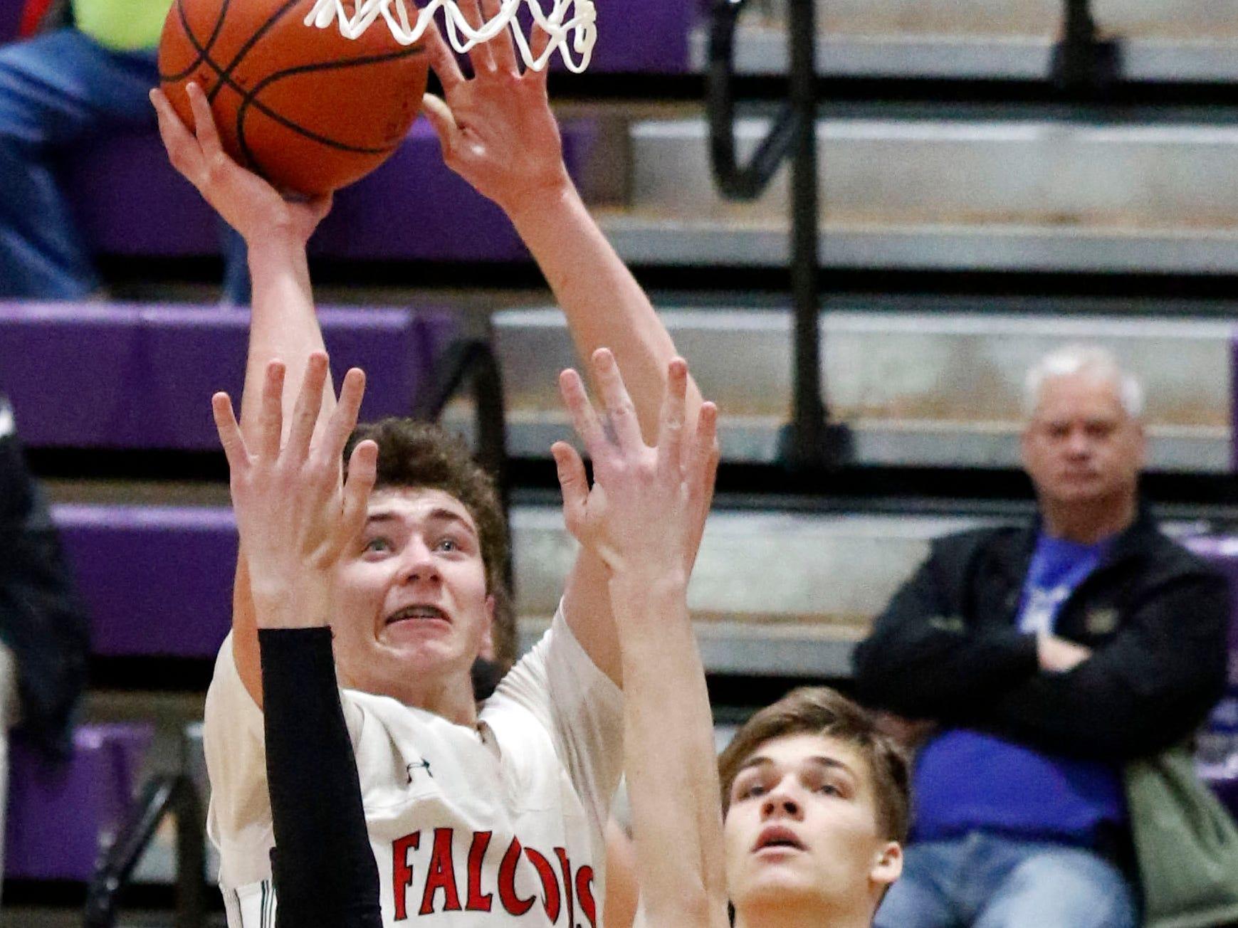 Fairfield Union's Huston Harrah takes a shot during Saturday's game, Feb. 23, 2019, at Logan High School in Logan. The Falcons defeated Marietta 48-33.