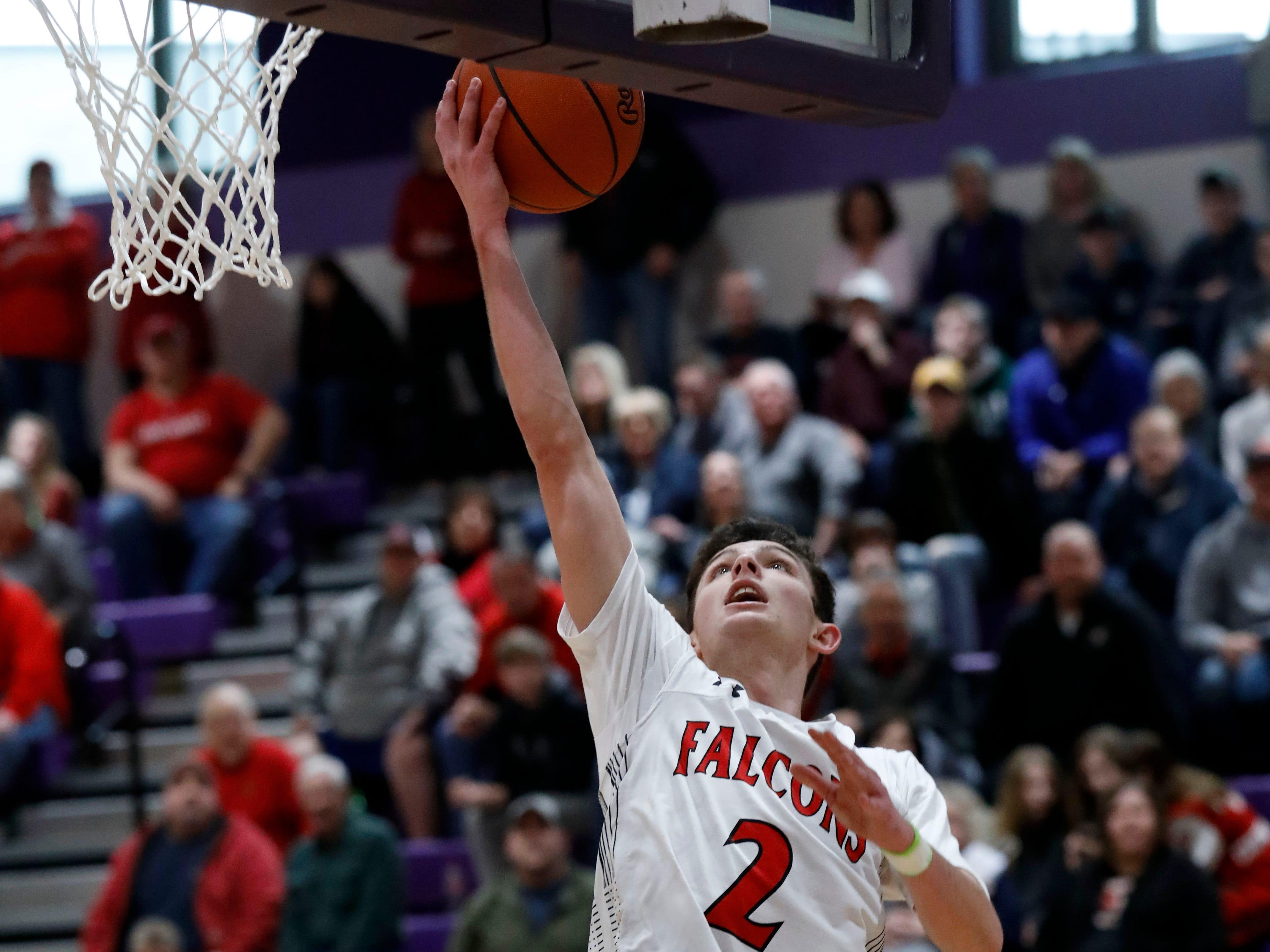 Fairfield Union's Evan Conley takes a shot during Saturday's game, Feb. 23, 2019, at Logan High School in Logan. The Falcons defeated Marietta 48-33.