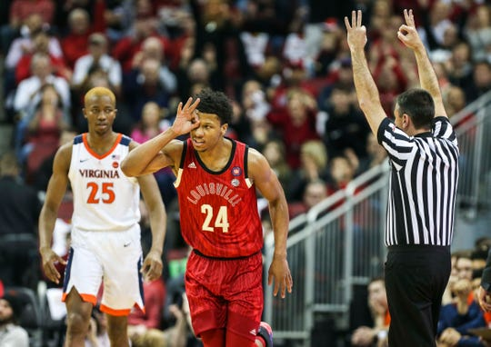 Louisville's Dwayne Sutton celebrates after hitting a 3-pointer against Virginia.