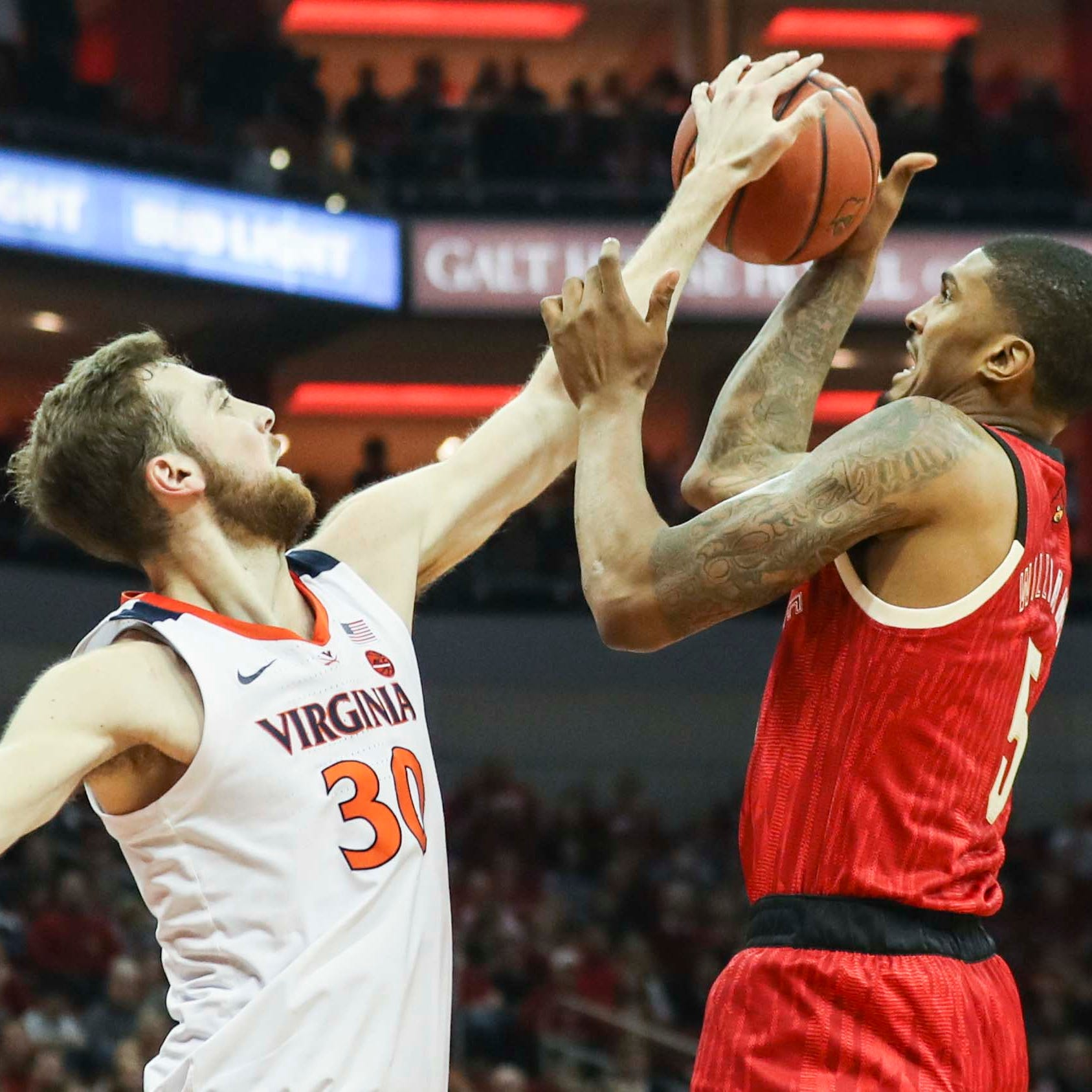 Louisville's tough stretch continues after blowing lead to Virginia