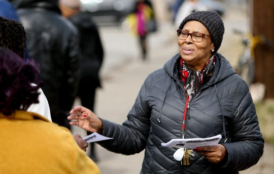 The Rev. Angela Johnson talks to people in line at a food pantry Grace Hope Presbyterian Church hosts in the Smoketown neighborhood.