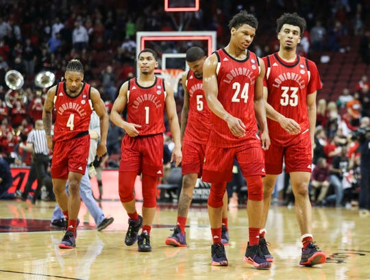 Louisville players walk off the court after the loss to Virginia Feb. 23, 2019. The Cards have dropped eight losses to Virginia.