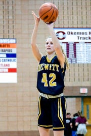 DeWitt's Hannah Kurncz makes a 3-pointer during the second quarter on Friday, Feb. 22, 2019, in Okemos.