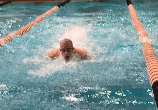 Lexington senior Wilson Cannon swims the butterfly as part of the fourth-place 200 medley relay team at the state meet. It was one of a school-record four medals Cannon earned in the meet.