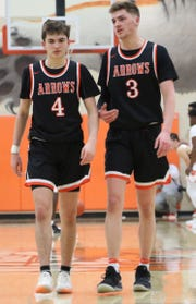 Ashland's Luke (left) and Garrett (right) Denbow played their final regular season game together on Friday night at Mansfield Senior.