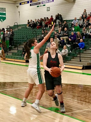 Marion Harding's Parkar Mauk drives to the basket in the second half at Dublin Scioto. The Irish prevailed in overtime 63-59 in a Division I girls basketball sectional final Friday night.
