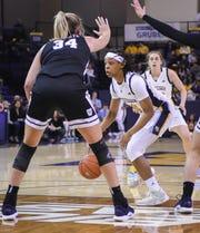 Marquette guard Allizia Blockton looks to pass around Butler forward/center Tori Schickel on Friday night.