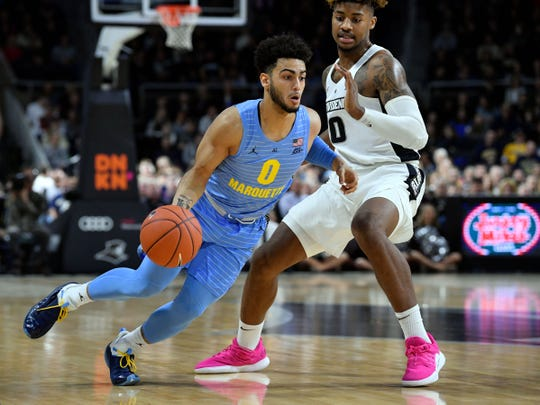 Marquette guard Markus Howard, left, and his Marquette teammates take the floor against Murray State on Thursday in a much-anticipated first round NCAA Tournament game.