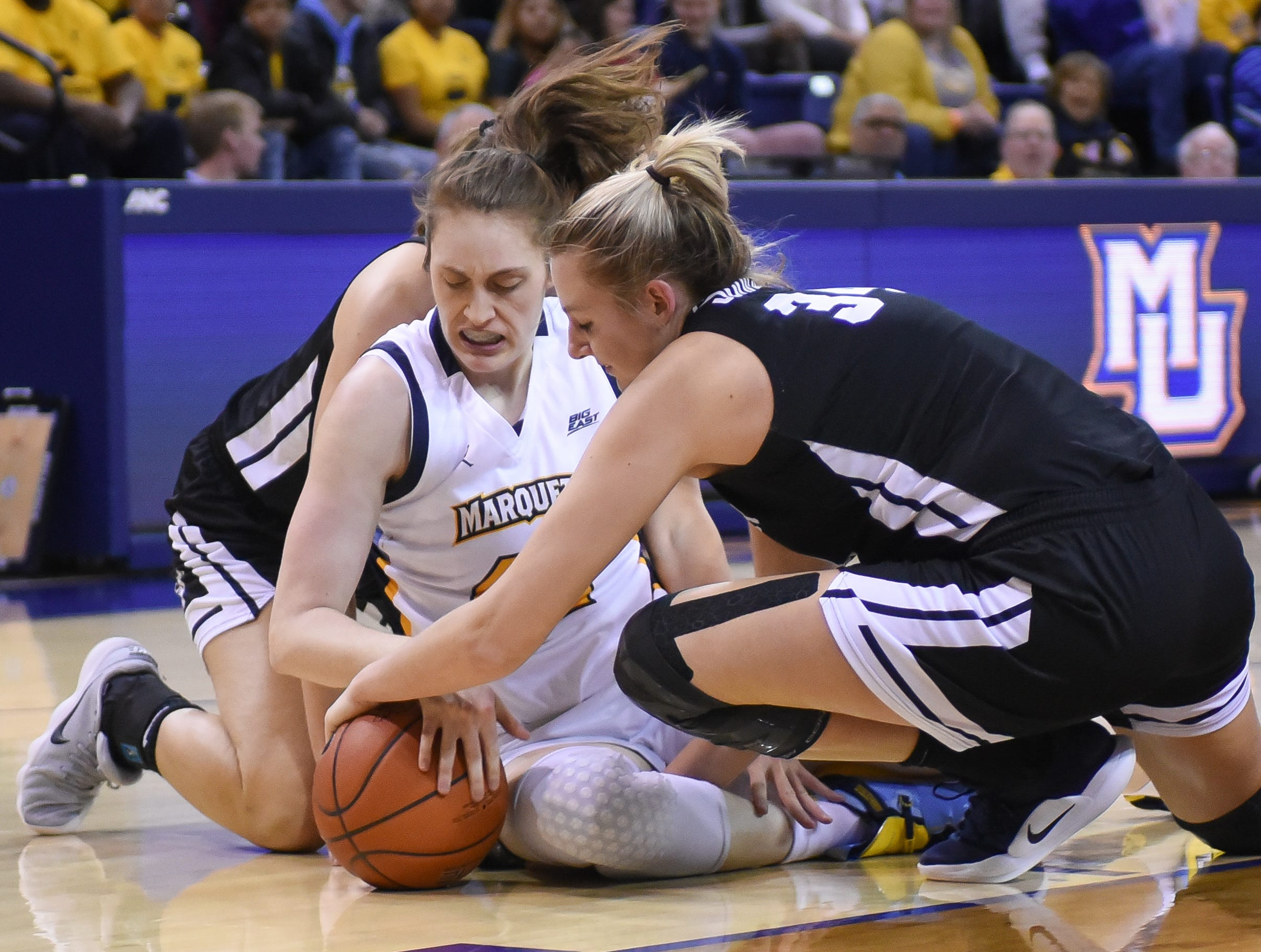 Marquette guard Lauren Van Kleunen wrestles with Butler forward/center Tori Schickel for a loose ball  in a Big East women's college basketball game Friday, February 22, 2019, at the Al McGuire Center.