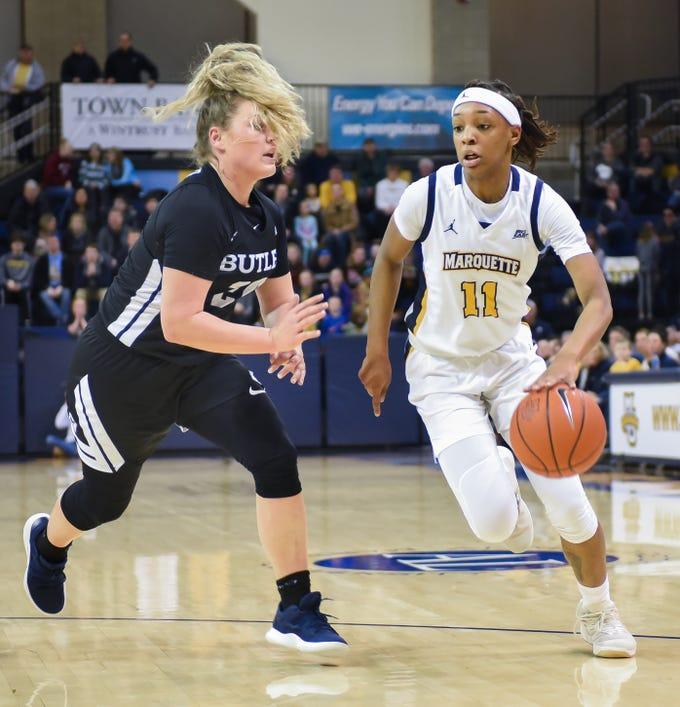 Marquette guard Allazia Blockton drives past Butler guard Kristen Spolyar in a Big East women's college basketball game Friday, February 22, 2019, at the Al McGuire Center.