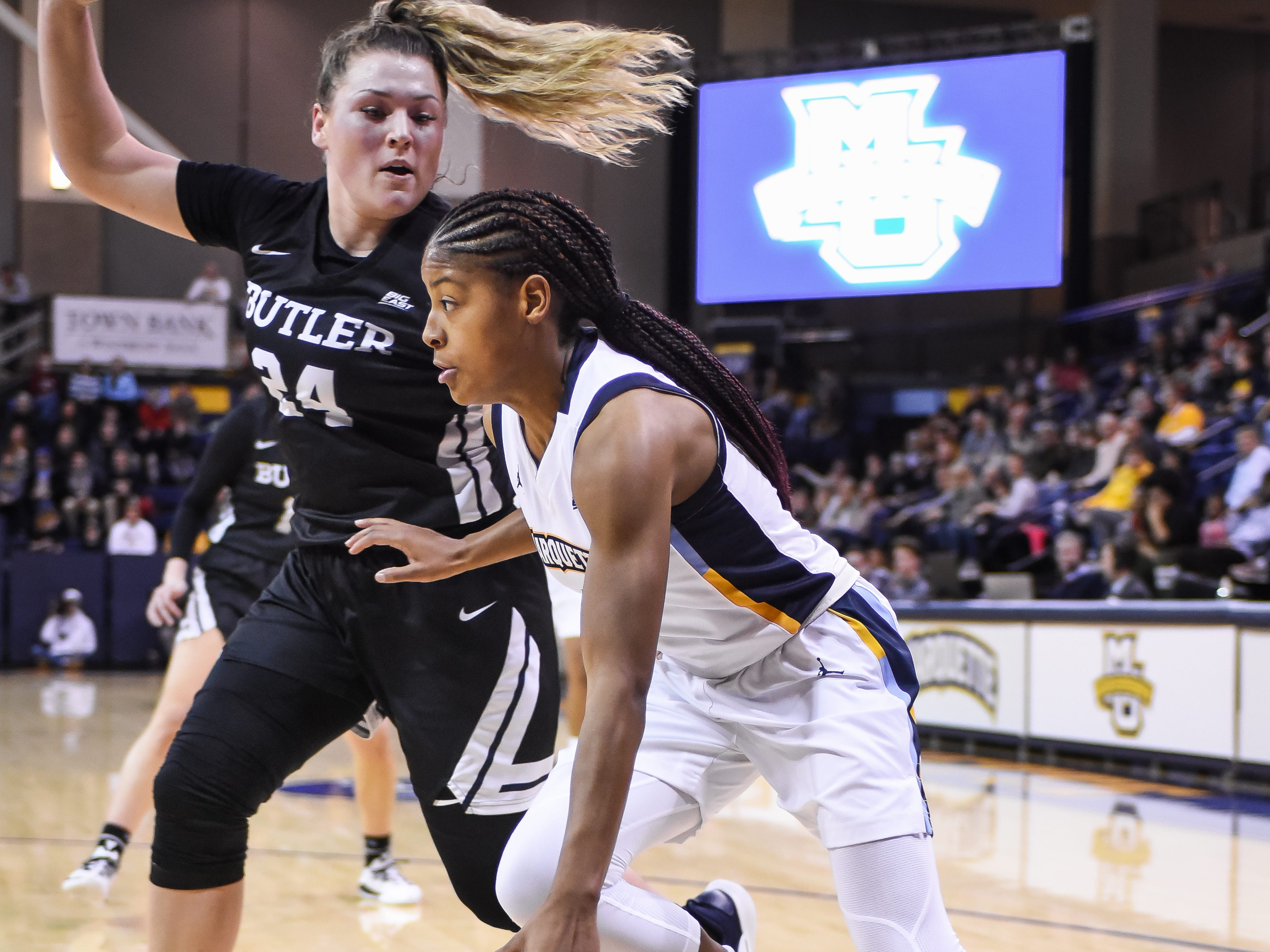 Marquette guard Danielle King drives the baseline past Butler forward/center Tori Schickel in a Big East women's college basketball game Friday, February 22, 2019, at the Al McGuire Center.
