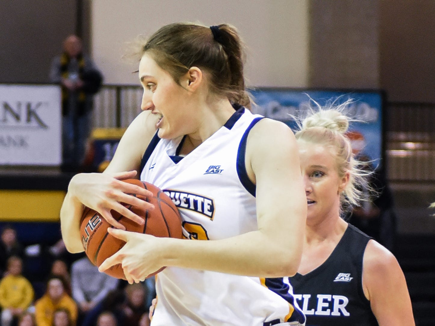 Marquette guard Lauren Van Kleunen recovers a long rebound in front of Butler guard Whitney Jennings in a Big East women's college basketball game Friday, February 22, 2019, at the Al McGuire Center.