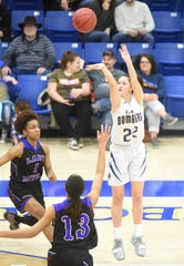 Mountain Home's Kate Gilbert launches a 3-pointer against West Memphis on Friday night.