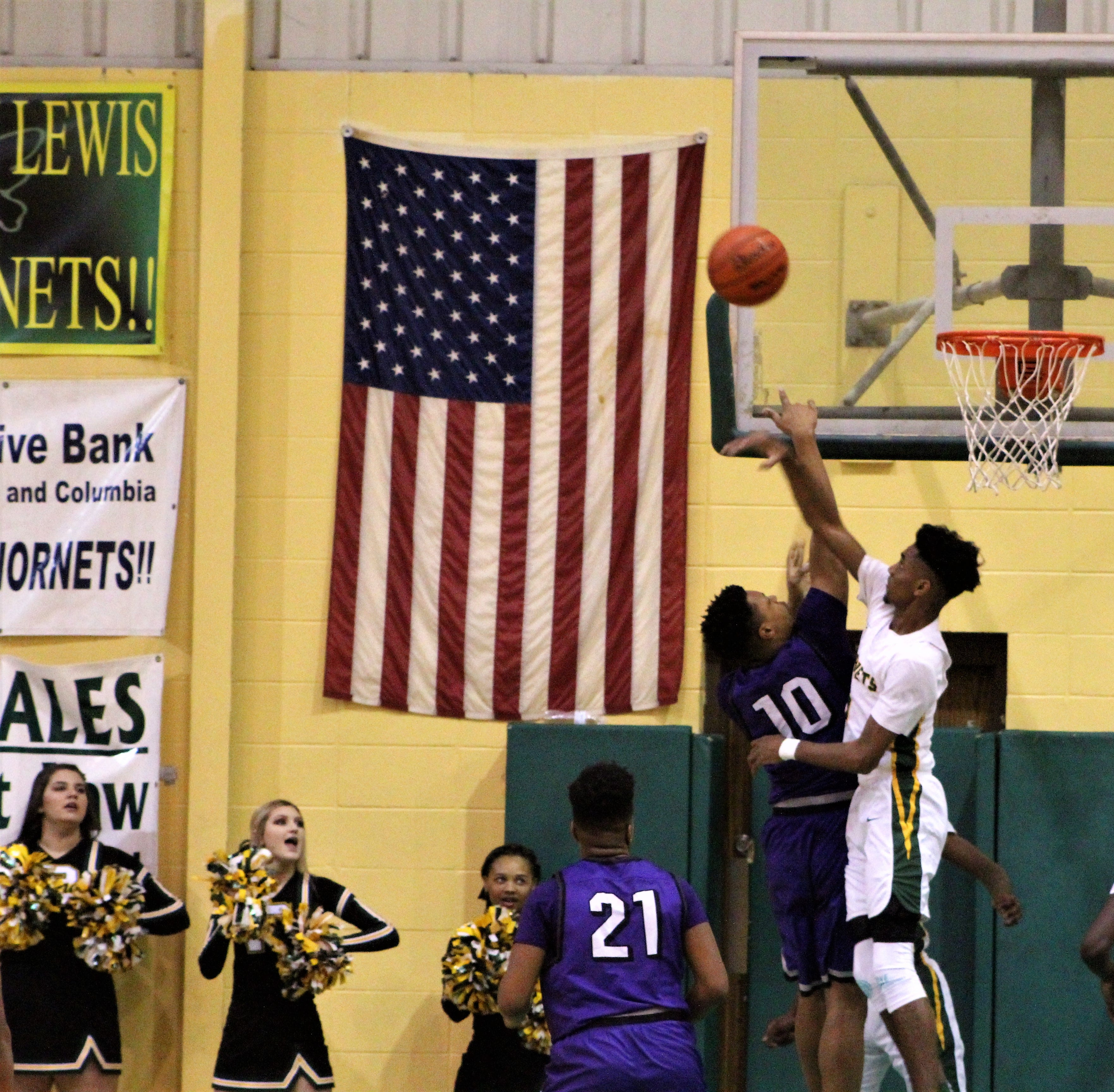 Rayville senior Mylik Wilson (1) rejects Mangham's Donnell Washington's (10) shot attempt in the bi-district playoff showdown at Rayville High School on Friday night.