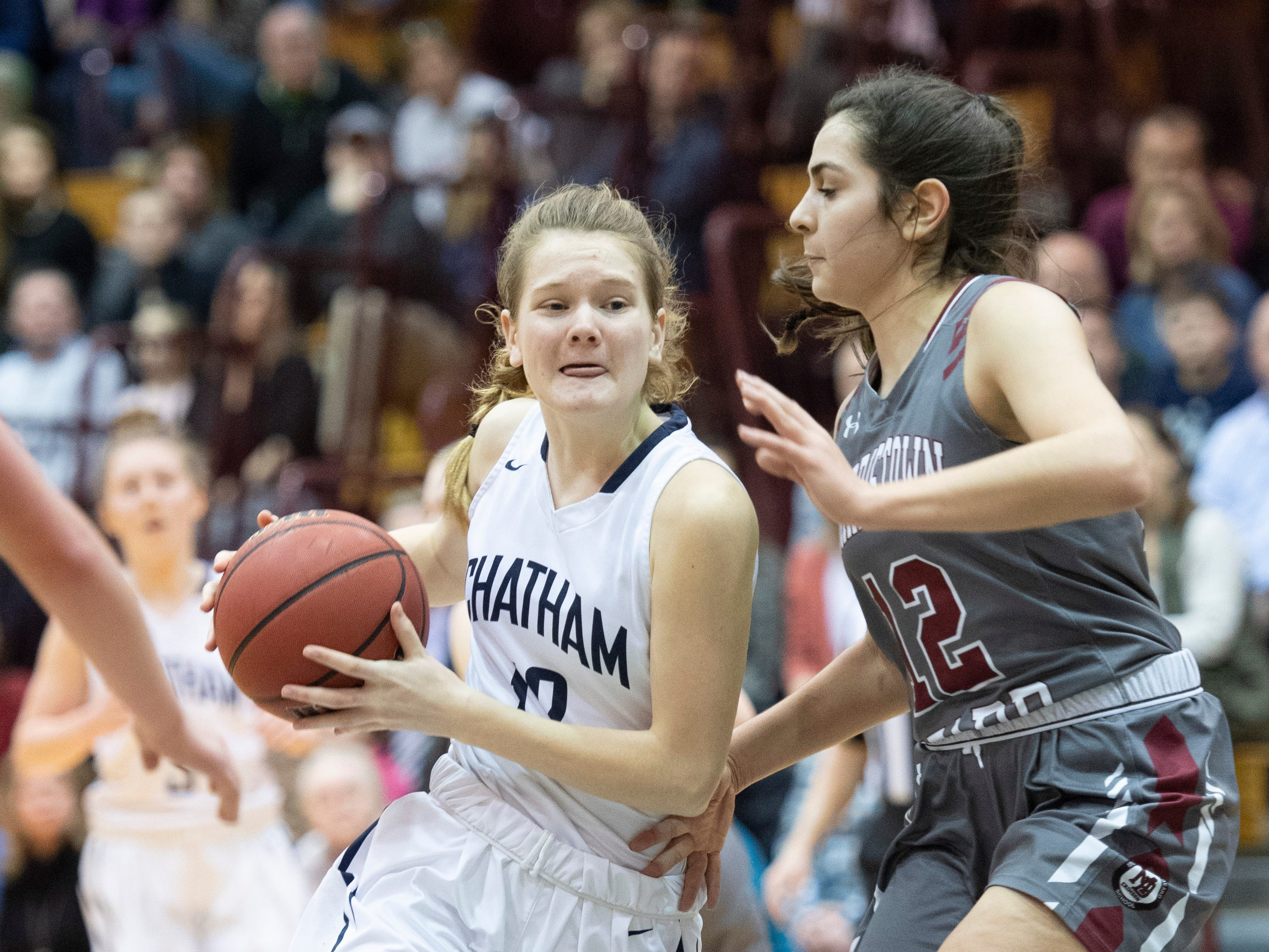 Chatham freshman forward Carly Frohnapfel drives to the basket as Morristown-Beard's Addisyn Ibrahim defends during the Morris County Tournament girls basketball final at County College of Morris in Randolph on Friday, February 22, 2019.