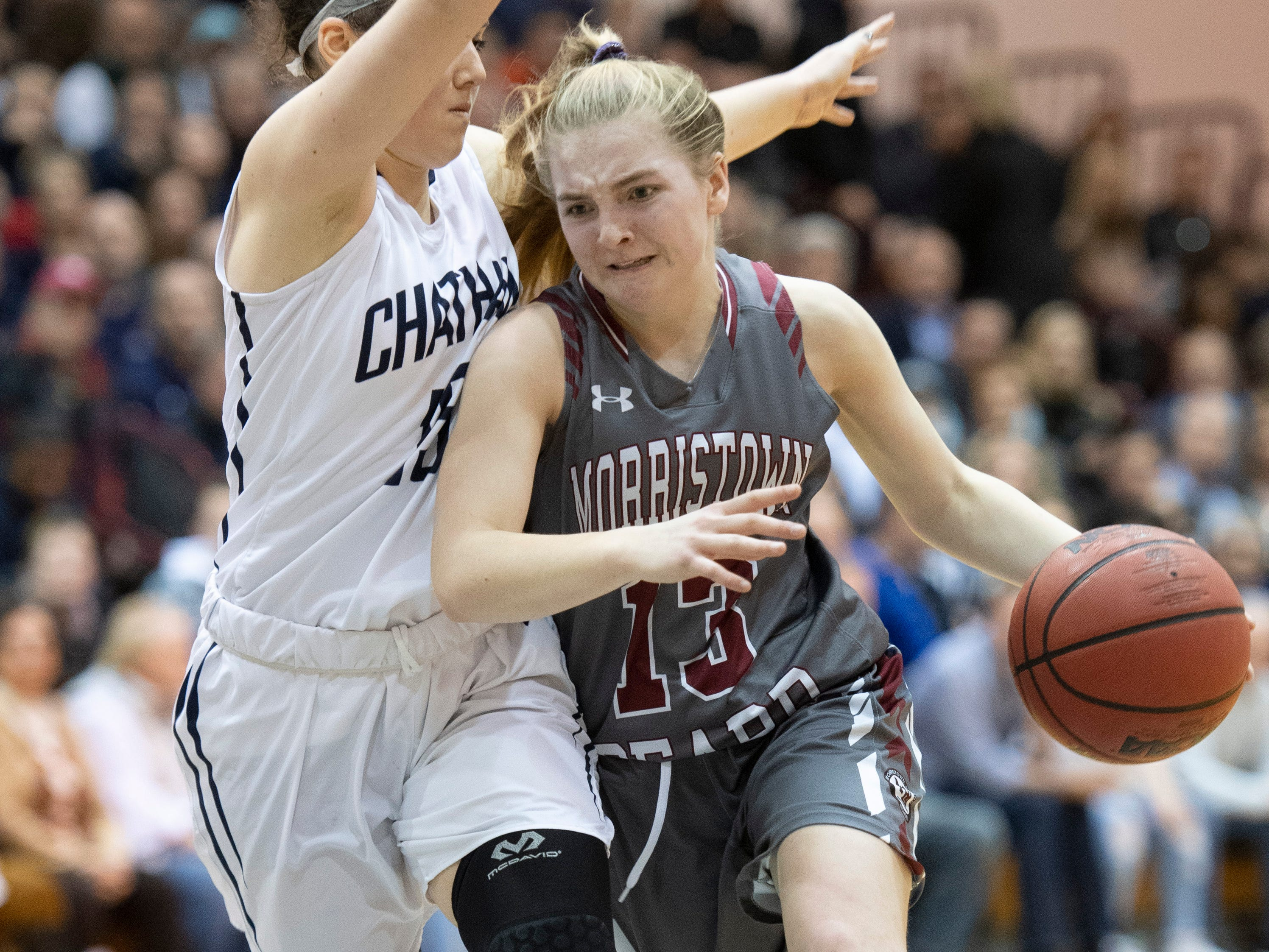 Chatham vs. Morristown-Beard in the Morris County Tournament girls basketball final at the County College of Morris in Randolph on Friday, February 22, 2019. MB #13 Olivia Omelczuk drives to the basket as C #15 Tess Ford defends.