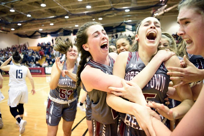 Chatham vs. Morristown-Beard in the Morris County Tournament girls basketball final at the County College of Morris in Randolph on Feb. 22, 2019. (center) MB #24 Bridget Monaghan celebrates with #25 Christina DeMattheis after DeMattheis scored the game-winning basket.