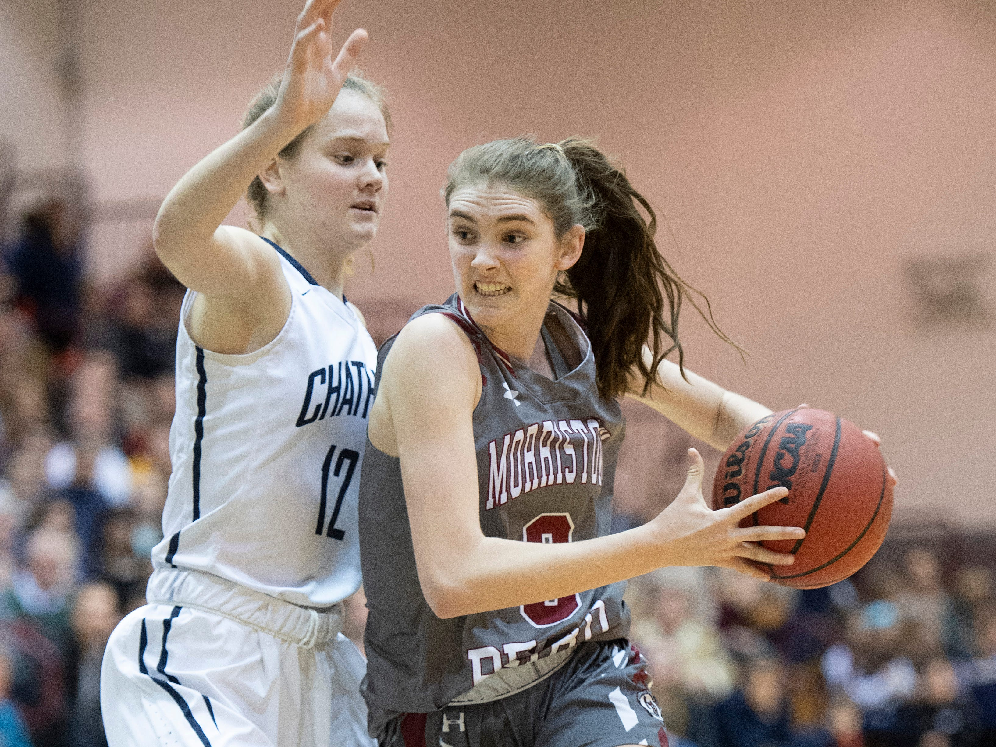 Chatham vs. Morristown-Beard in the Morris County Tournament girls basketball final at the County College of Morris in Randolph on Friday, February 22, 2019. MB #3 Erin Martin drives to the basket as C #12 Carly Frohnapfel defends.